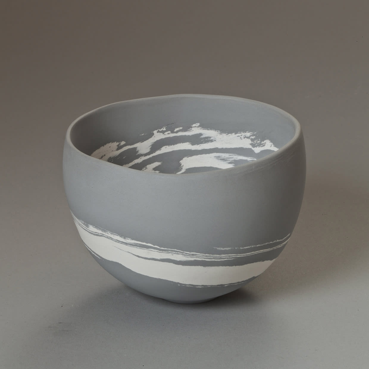 """<span class=""""link fancybox-details-link""""><a href=""""/content/feature/35/artworks7970/"""">View Detail Page</a></span><div class=""""signed_and_dated"""">signed to the base</div> <div class=""""medium"""">grey and white porcelain</div> <div class=""""dimensions"""">h. 8 cm x dia. 11 cm</div>"""