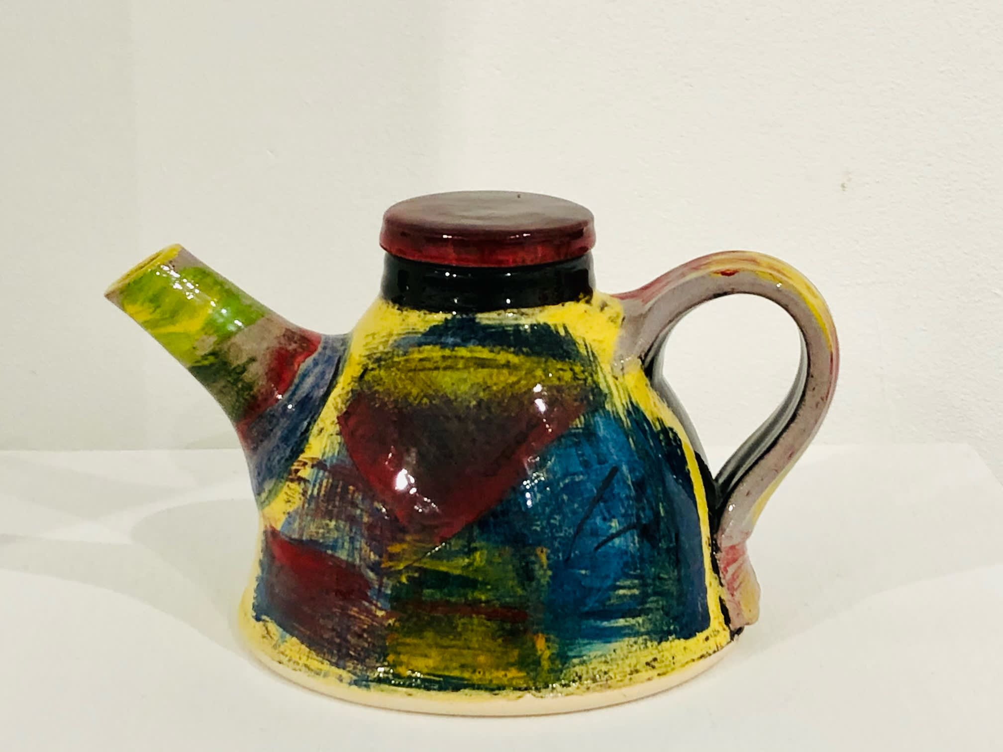 """<span class=""""link fancybox-details-link""""><a href=""""/artists/100-john-pollex/works/7321-john-pollex-teapot-2020/"""">View Detail Page</a></span><div class=""""artist""""><strong>John Pollex</strong></div> b. 1941 <div class=""""title""""><em>Teapot</em>, 2020</div> <div class=""""signed_and_dated"""">impressed with the artist's seal mark 'JP'</div> <div class=""""medium"""">white earthenware decorated with coloured slips</div><div class=""""price"""">£220.00</div><div class=""""copyright_line"""">£22 x 10 month 0% APR</div>"""