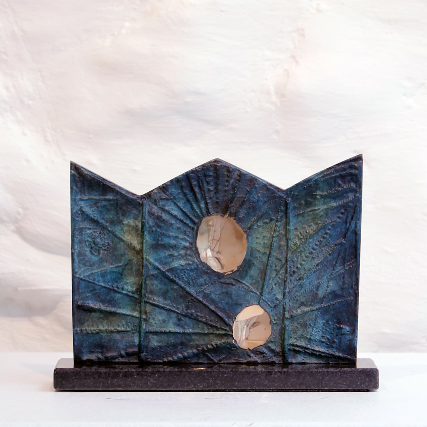 """<span class=""""link fancybox-details-link""""><a href=""""/artists/69-margaret-lovell-d.litt.-hon-frbs-rwa/works/7459-margaret-lovell-d.litt.-hon-frbs-rwa-triptych-f-1965/"""">View Detail Page</a></span><div class=""""artist""""><strong>Margaret Lovell D.Litt. Hon FRBS RWA</strong></div> b. 1939 <div class=""""title""""><em>Triptych F</em>, 1965</div> <div class=""""signed_and_dated"""">stamped with the initials 'ML' and the edition number, by the artist</div> <div class=""""medium"""">cast bronze (patinated) on granite base</div> <div class=""""dimensions"""">10 x 15 x 4 cm<br /> 4 x 5 7/8 x 1 5/8 in</div> <div class=""""edition_details"""">Artist's Copy 1 of 2, aside from the edition of 4</div><div class=""""price"""">£945.00</div><div class=""""copyright_line"""">Own Art: £ 94.50 x 10 Months, 0% APR</div>"""