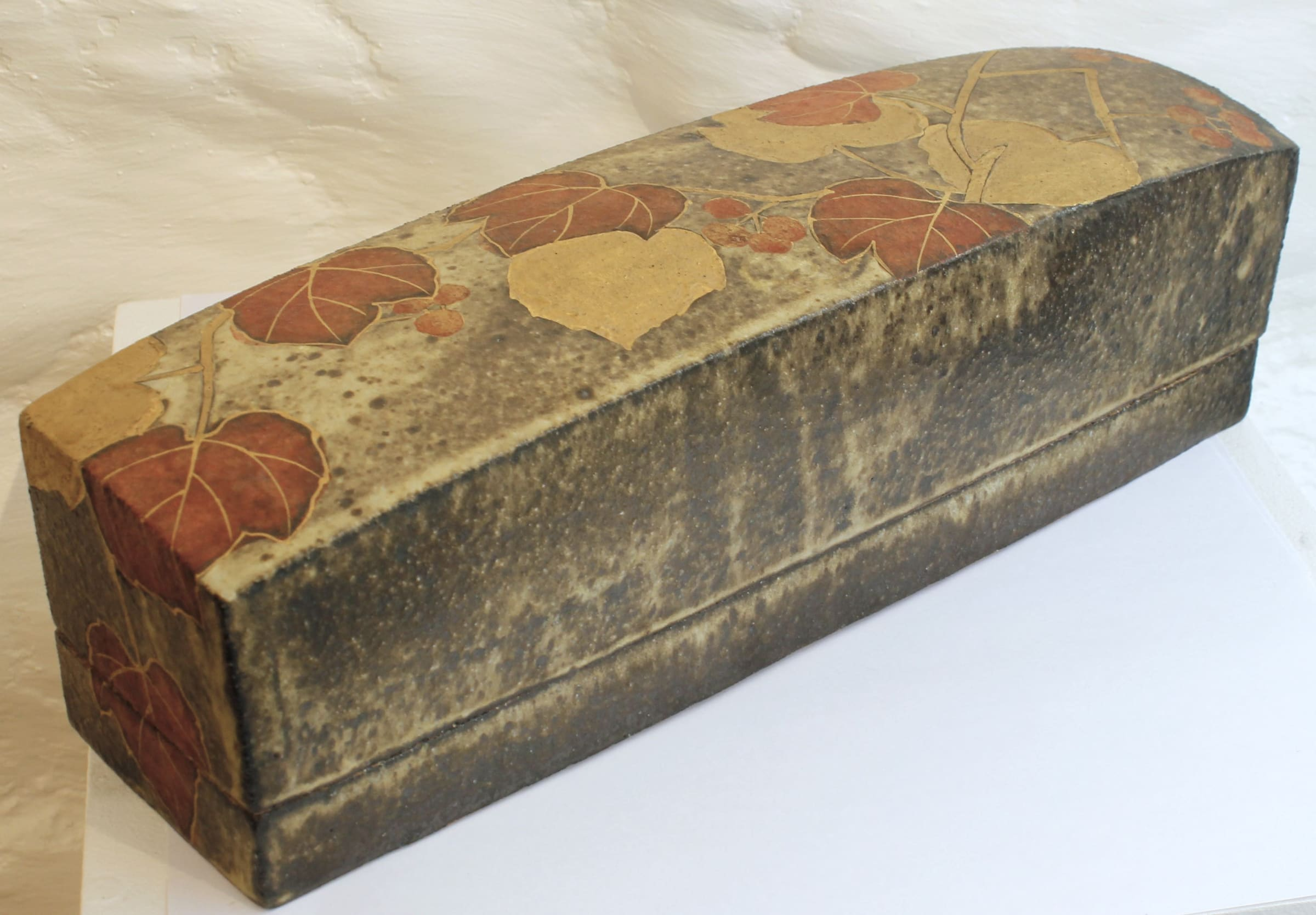 """<span class=""""link fancybox-details-link""""><a href=""""/artists/191-tadami-hirota/works/4958-tadami-hirota-long-rectangular-box-with-vine-leaves-2017/"""">View Detail Page</a></span><div class=""""artist""""><strong>Tadami Hirota</strong></div> b. 1949 <div class=""""title""""><em>Long Rectangular Box with Vine Leaves</em>, 2017</div> <div class=""""dimensions"""">h. 10 x w. 34 x d. 9.5 cm </div><div class=""""price"""">£1,000.00</div><div class=""""copyright_line"""">OwnArt: £ 100 x 10 Months, 0% APR</div>"""