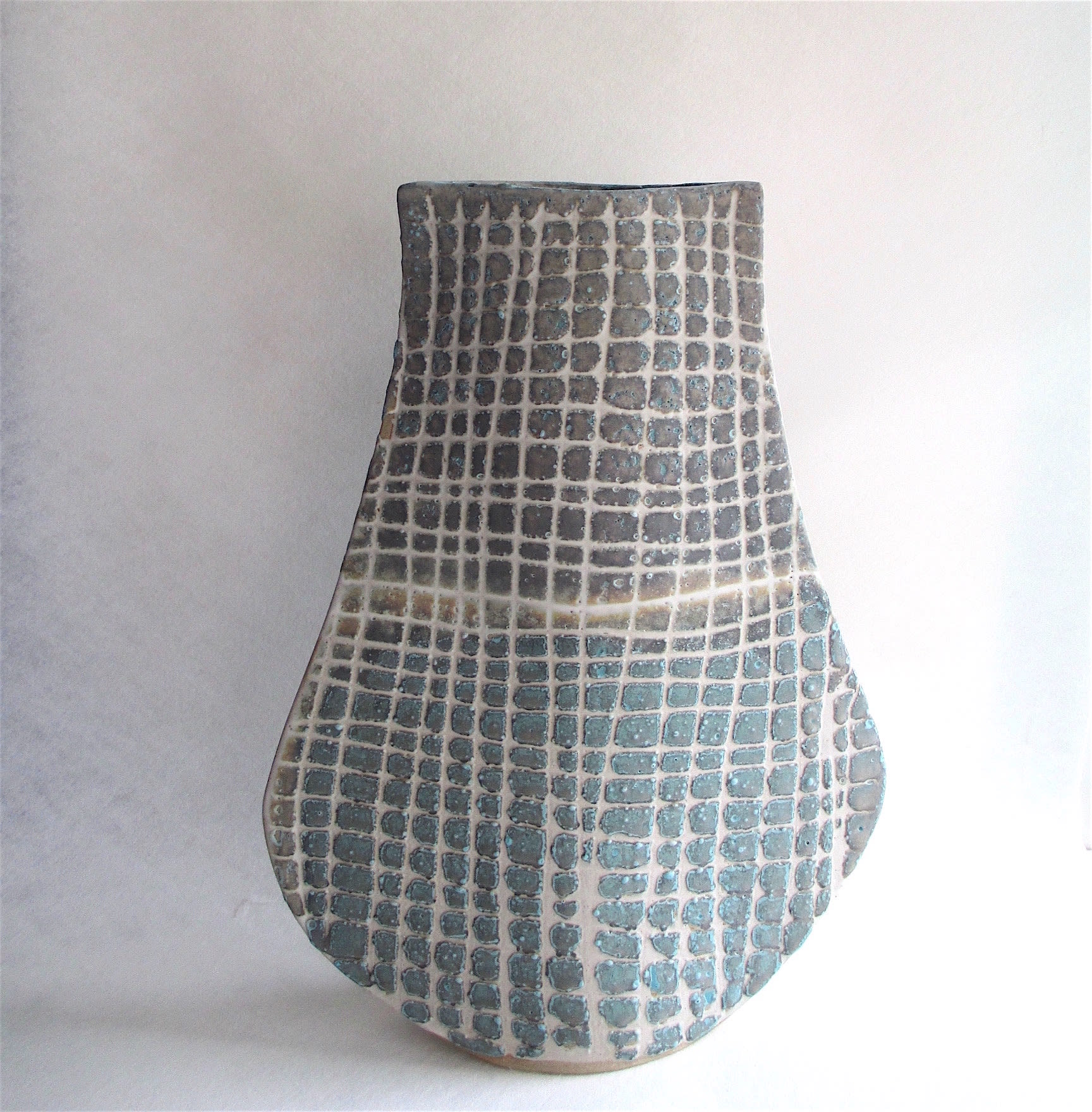 """<span class=""""link fancybox-details-link""""><a href=""""/artists/44-sarah-perry/works/5963-sarah-perry-grid-bottle-ellipse-2018/"""">View Detail Page</a></span><div class=""""artist""""><strong>Sarah Perry</strong></div> b. 1945 <div class=""""title""""><em>Grid Bottle Ellipse</em>, 2018</div> <div class=""""signed_and_dated"""">impressed with the artist's seal mark 'SP'</div> <div class=""""medium"""">stoneware</div> <div class=""""dimensions"""">h 43</div><div class=""""copyright_line"""">Own Art: £ 70.50 x 10 Months, 0% APR</div>"""