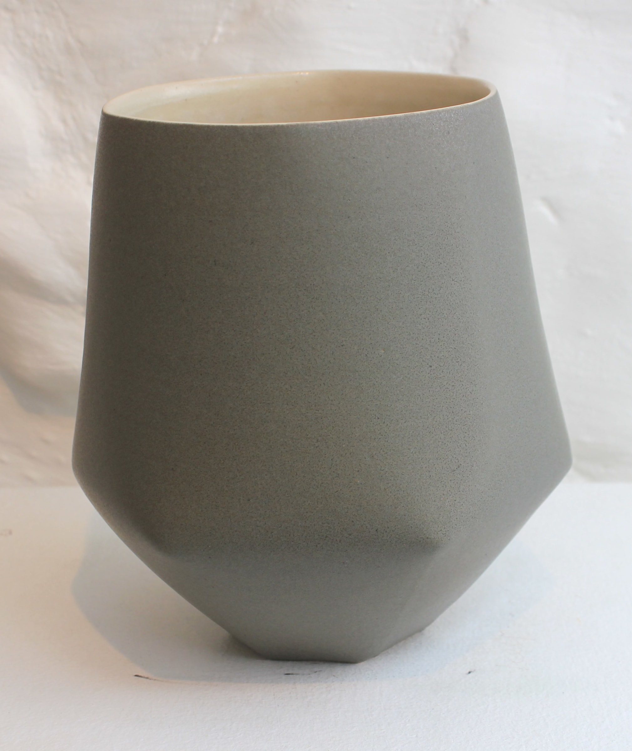 """<span class=""""link fancybox-details-link""""><a href=""""/artists/33-sun-kim/works/5737-sun-kim-medium-vase-2018/"""">View Detail Page</a></span><div class=""""artist""""><strong>Sun Kim</strong></div> <div class=""""title""""><em>Medium Vase</em>, 2018</div> <div class=""""signed_and_dated"""">stamped by the artist</div> <div class=""""medium"""">porcelain</div> <div class=""""dimensions"""">15 x 15 x 11 cm<br /> 5 7/8 x 5 7/8 x 4 3/8 inches</div><div class=""""price"""">£300.00</div><div class=""""copyright_line"""">OwnArt: £ 30 x 10 Months, 0% APR</div>"""
