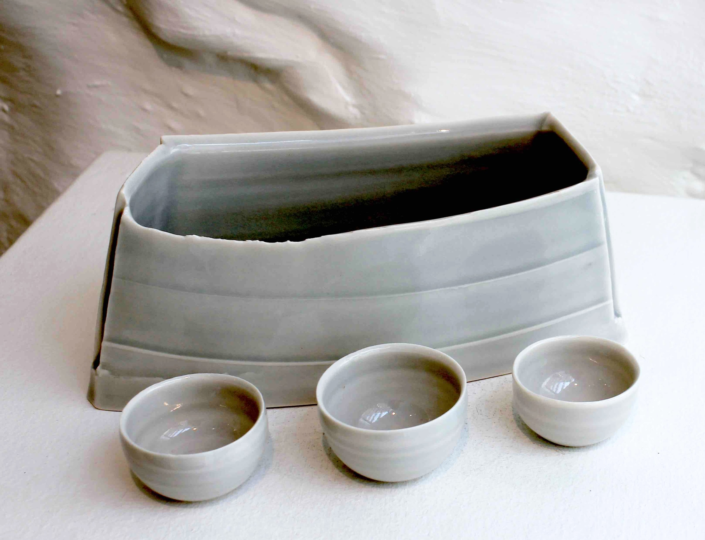 """<span class=""""link fancybox-details-link""""><a href=""""/artists/99-carina-ciscato/works/5767-carina-ciscato-pale-grey-blue-elongated-pot-with-three-bowls-2018/"""">View Detail Page</a></span><div class=""""artist""""><strong>Carina Ciscato</strong></div> b. 1970 <div class=""""title""""><em>Pale Grey/Blue Elongated Pot with Three Bowls</em>, 2018</div> <div class=""""signed_and_dated"""">porcelain</div> <div class=""""medium"""">porcelain</div> <div class=""""dimensions"""">17 x 23 cm<br /> 6 3/4 x 9 1/8 inches</div><div class=""""price"""">£280.00</div><div class=""""copyright_line"""">OwnArt: £28 x 10 Months, 0% APR</div>"""