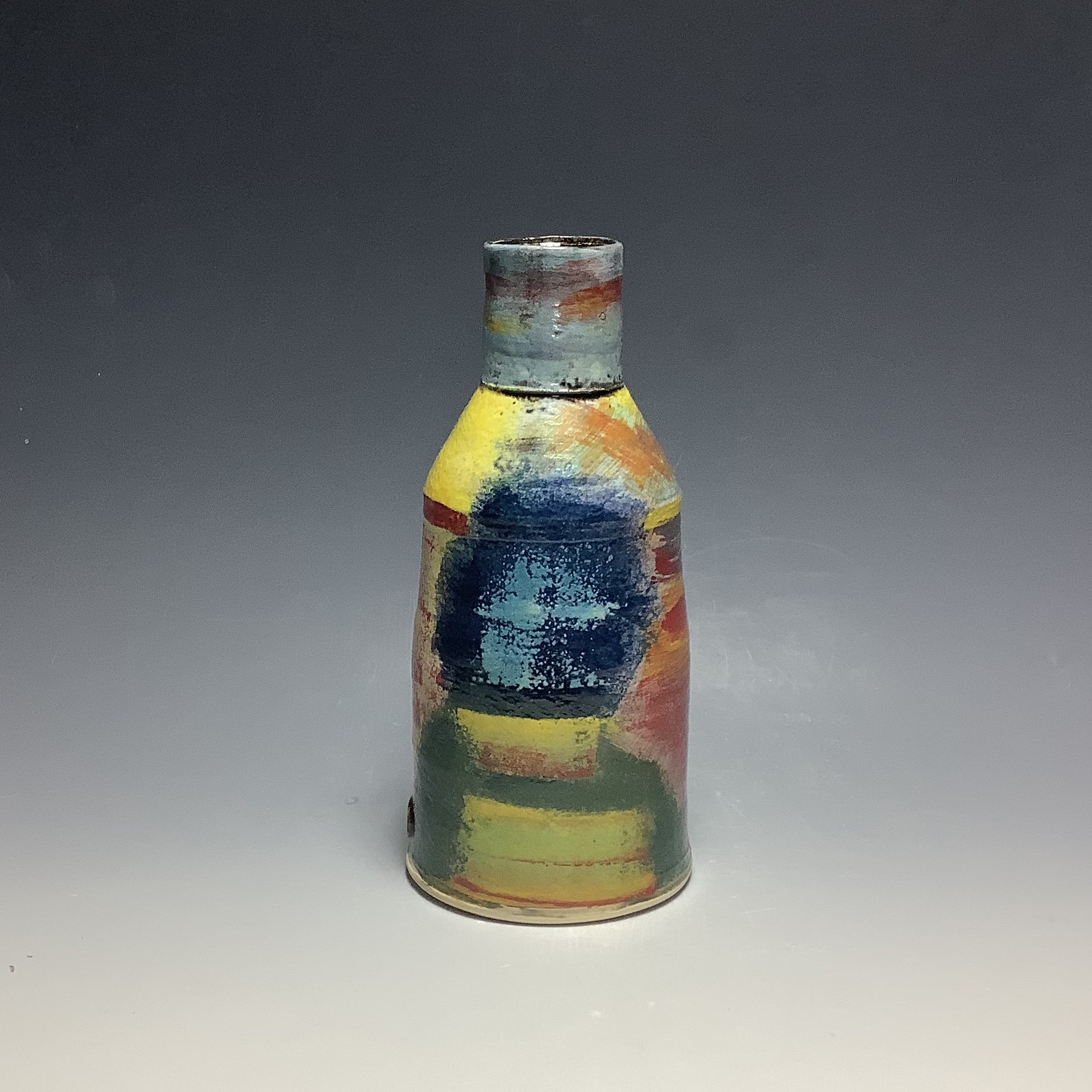 """<span class=""""link fancybox-details-link""""><a href=""""/artists/100-john-pollex/works/6837-john-pollex-small-bottle-2020/"""">View Detail Page</a></span><div class=""""artist""""><strong>John Pollex</strong></div> b. 1941 <div class=""""title""""><em>Small Bottle</em>, 2020</div> <div class=""""signed_and_dated"""">impressed with the artist's seal mark 'JP'</div> <div class=""""medium"""">white earthenware decorated with coloured slips</div> <div class=""""dimensions"""">h. 7.5 in</div><div class=""""copyright_line"""">Ownart: £176 x 10 Months, 0% APR</div>"""