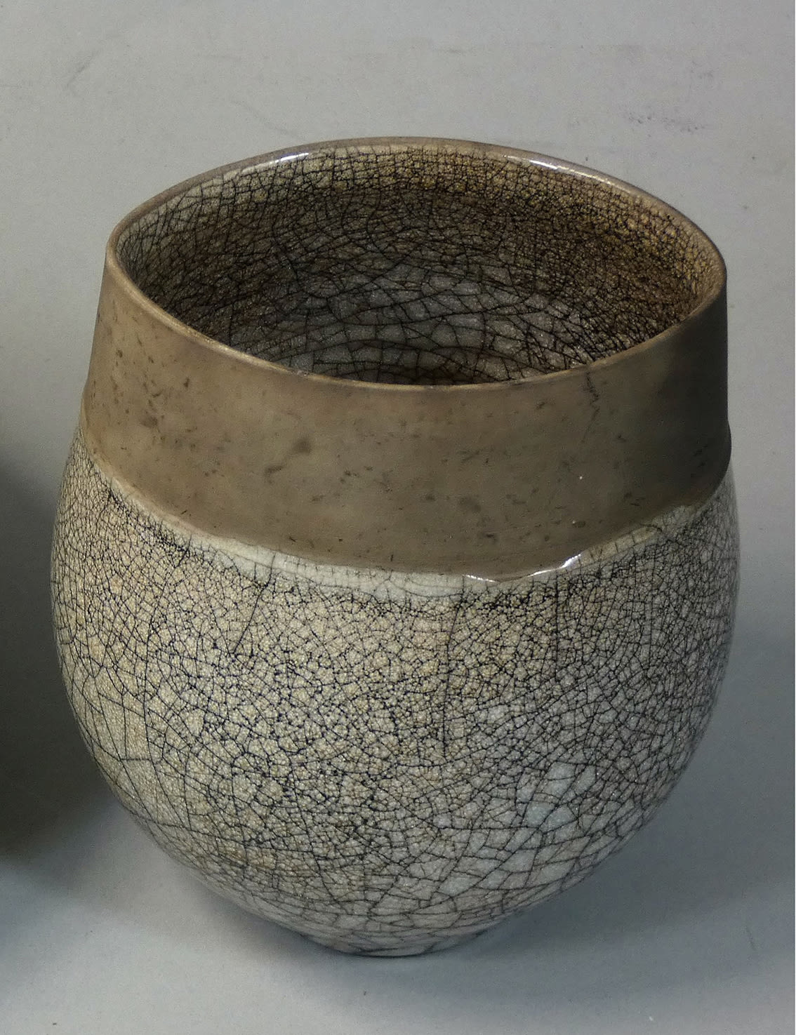 "<span class=""link fancybox-details-link""><a href=""/artists/98-tim-andrews/works/7141-tim-andrews-ovoid-vase/"">View Detail Page</a></span><div class=""artist""><strong>Tim Andrews</strong></div> b. 1960 <div class=""title""><em>Ovoid Vase</em></div> <div class=""signed_and_dated"">impressed monogram 'TA'</div> <div class=""medium"">Raku with 'crackle glaze'</div> <div class=""dimensions"">h. 12 cm<br /> 4 3/4 in.</div><div class=""price"">£180.00</div><div class=""copyright_line"">Own Art: £18 x 10 months 0% APR</div>"