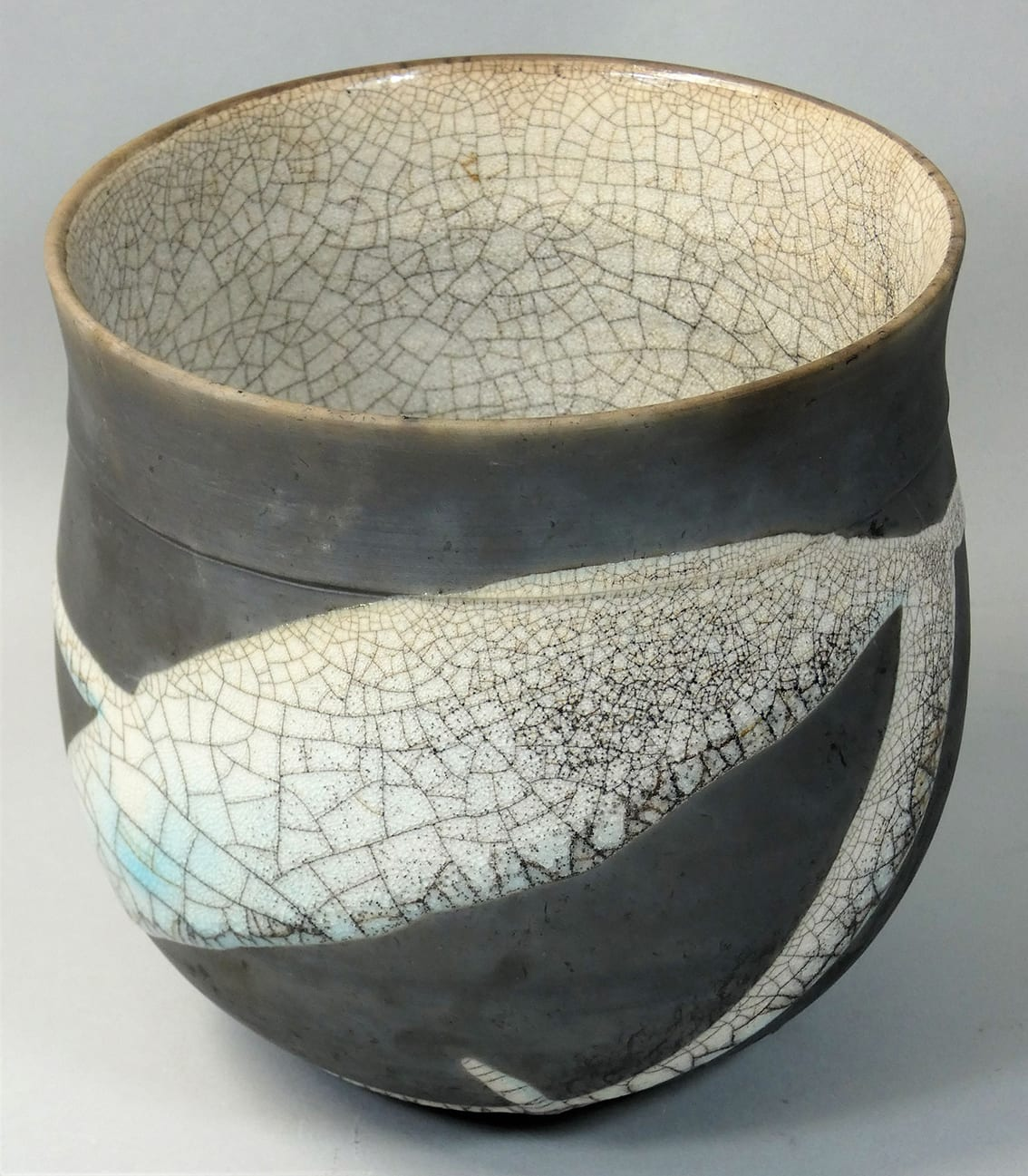 "<span class=""link fancybox-details-link""><a href=""/artists/98-tim-andrews/works/7142-tim-andrews-bowl/"">View Detail Page</a></span><div class=""artist""><strong>Tim Andrews</strong></div> b. 1960 <div class=""title""><em>Bowl</em></div> <div class=""signed_and_dated"">impressed monogram 'TA'</div> <div class=""medium"">Raku with 'crackle glaze' interior</div> <div class=""dimensions"">h. 16 cm<br /> h. 6 1/4 in.</div><div class=""price"">£220.00</div><div class=""copyright_line"">Own Art: £22 x 10 months 0% APR</div>"