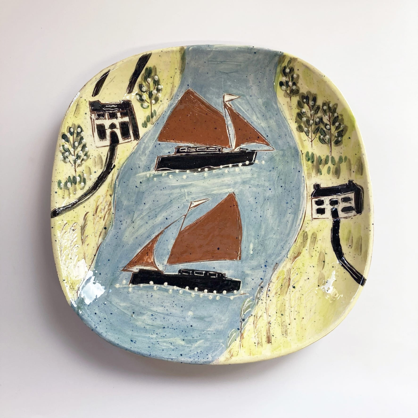 """<span class=""""link fancybox-details-link""""><a href=""""/artists/428-anne-barrell/works/7634-anne-barrell-red-sails-in-the-creek-2021/"""">View Detail Page</a></span><div class=""""artist""""><strong>Anne Barrell</strong></div> <div class=""""title""""><em>Red Sails in the Creek</em>, 2021</div> <div class=""""medium"""">handmade, handpainted ceramic</div> <div class=""""dimensions"""">23 x 23 cm</div><div class=""""copyright_line"""">Ownart: £9.70 x 10 Months, 0% APR</div>"""