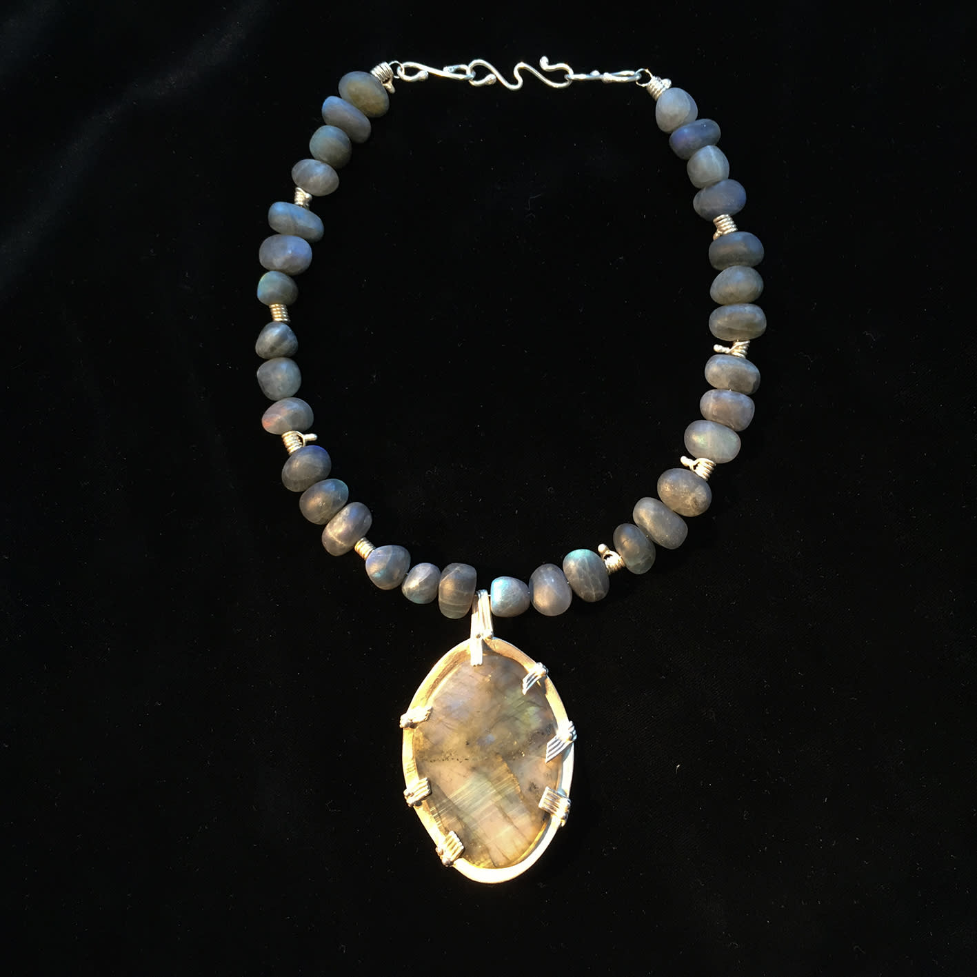"<span class=""link fancybox-details-link""><a href=""/artists/186-helen-feiler/works/6744-helen-feiler-labradorite-pendant-with-labradorite-beads-and-silver-2019/"">View Detail Page</a></span><div class=""artist""><strong>Helen Feiler</strong></div> <div class=""title""><em>Labradorite Pendant with Labradorite Beads and Silver</em>, 2019</div> <div class=""medium"">Labradorite and silver on stainless steel wire</div><div class=""copyright_line"">Own Art: £88.00 x 10 monthly payments</div>"