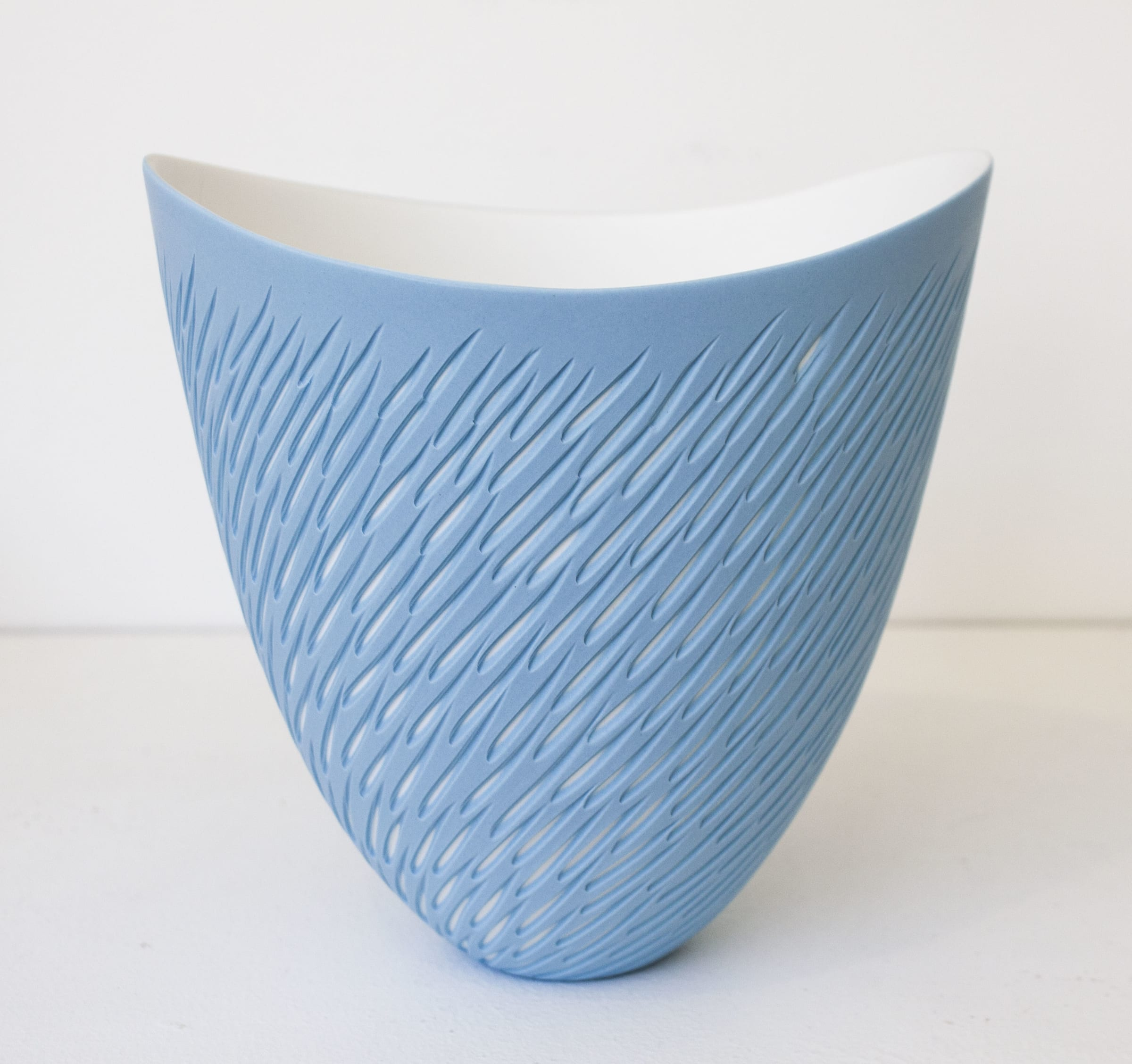 "<span class=""link fancybox-details-link""><a href=""/artists/60-sasha-wardell/works/7785-sasha-wardell-blue-shoal-curved-rim-vase-2021/"">View Detail Page</a></span><div class=""artist""><strong>Sasha Wardell</strong></div> <div class=""title""><em>Blue 'Shoal' Curved Rim Vase</em>, 2021</div> <div class=""medium"">bone china</div> <div class=""dimensions"">h. 16 cm</div><div class=""price"">£210.00</div><div class=""copyright_line"">Own Art: £21 x 10 Months, 0% APR</div>"
