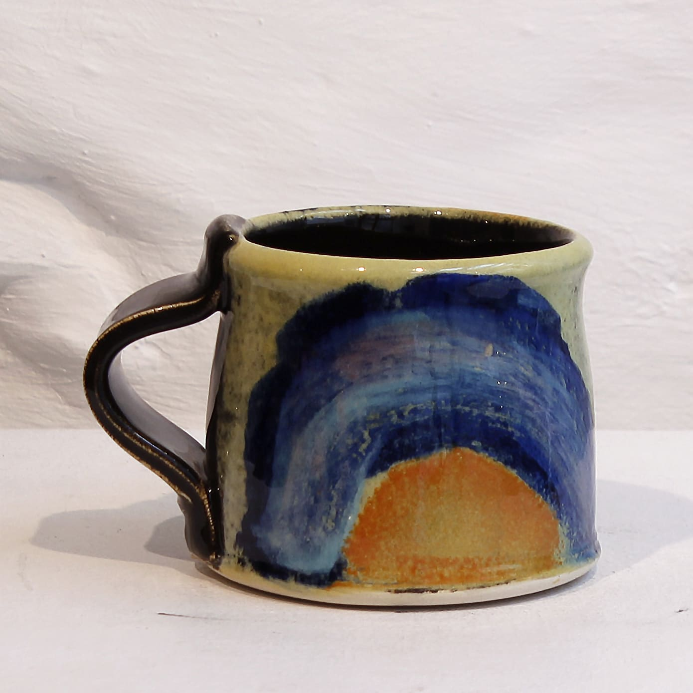 """<span class=""""link fancybox-details-link""""><a href=""""/artists/100-john-pollex/works/5934-john-pollex-small-mug-5-2018/"""">View Detail Page</a></span><div class=""""artist""""><strong>John Pollex</strong></div> b. 1941 <div class=""""title""""><em>Small Mug 5</em>, 2018</div> <div class=""""signed_and_dated"""">impressed with the artist's seal mark 'JP'</div> <div class=""""medium"""">white earthenware decorated with coloured slips</div><div class=""""price"""">£50.00</div><div class=""""copyright_line"""">Copyright The Artist</div>"""