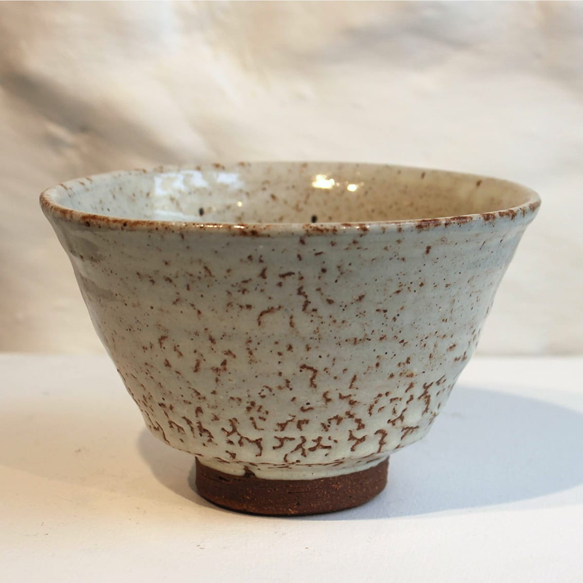 """<span class=""""link fancybox-details-link""""><a href=""""/artists/200-matthew-tyas/works/5462-matthew-tyas-tenmoku-ash-chawan-bowl-2018/"""">View Detail Page</a></span><div class=""""artist""""><strong>Matthew Tyas</strong></div> <div class=""""title""""><em>Tenmoku Ash Chawan Bowl</em>, 2018</div> <div class=""""signed_and_dated"""">stamped by the artist</div> <div class=""""medium"""">glazed thrown stoneware</div><div class=""""copyright_line"""">Copyright The Artist</div>"""