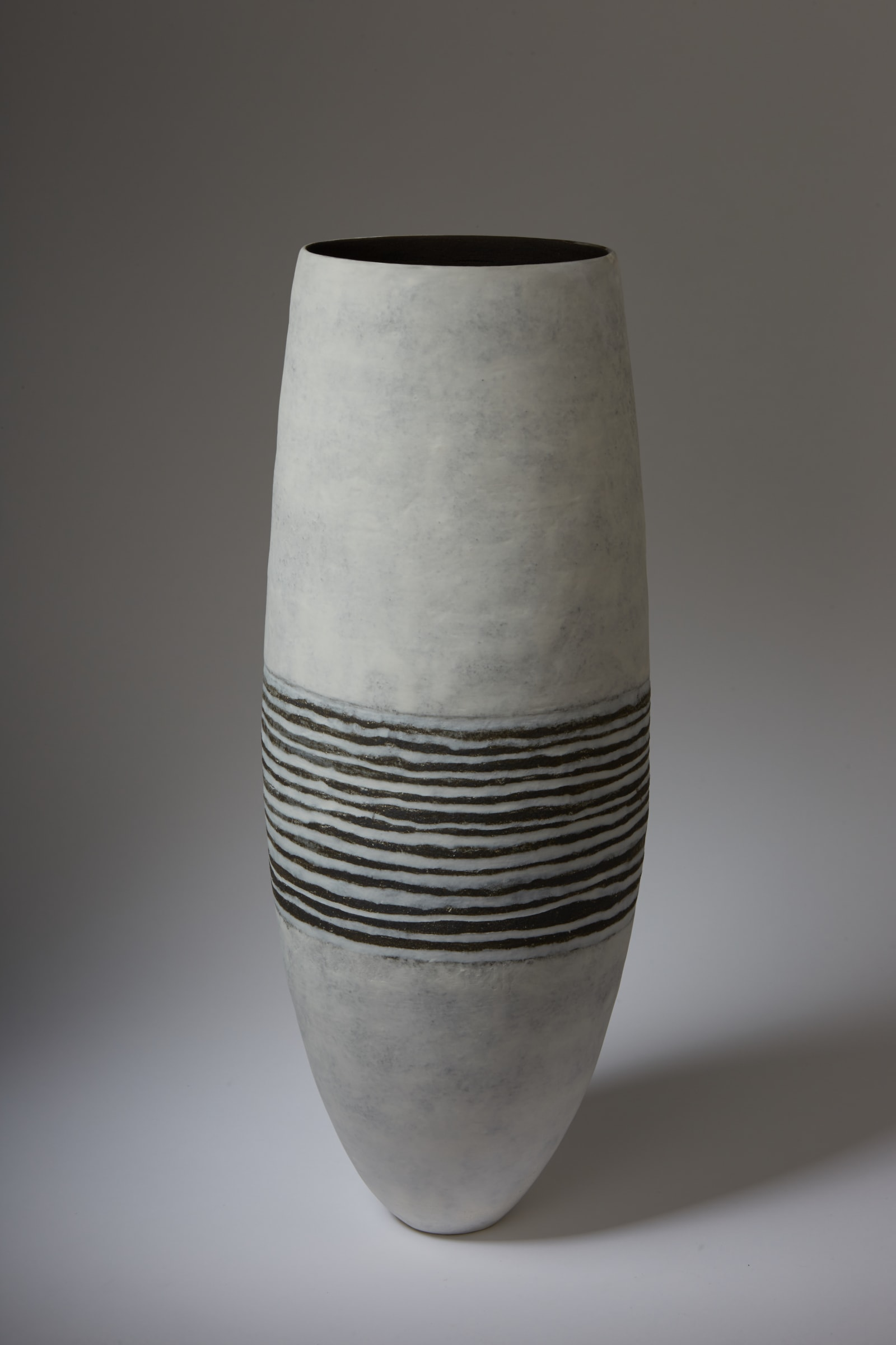 """<span class=""""link fancybox-details-link""""><a href=""""/content/feature/35/artworks7972/"""">View Detail Page</a></span><div class=""""signed_and_dated"""">signed to the base</div> <div class=""""medium"""">stoneware and white porcelain, with porcelain slip</div> <div class=""""dimensions"""">h. 57 cm x w. 20 cm x d. 16 cm</div>"""
