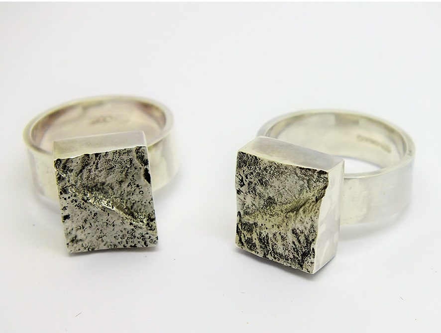 """<span class=""""link fancybox-details-link""""><a href=""""/artists/154-stacey-west/works/3933-stacey-west-interlocking-strata-ring-pair-porthminster-2017/"""">View Detail Page</a></span><div class=""""artist""""><strong>Stacey West</strong></div> <div class=""""title""""><em>'Interlocking Strata' Ring Pair – Porthminster</em>, 2017</div> <div class=""""medium"""">Solid sterling silver interlocking</div><div class=""""price"""">£245.00</div><div class=""""copyright_line"""">Copyright The Artist</div>"""