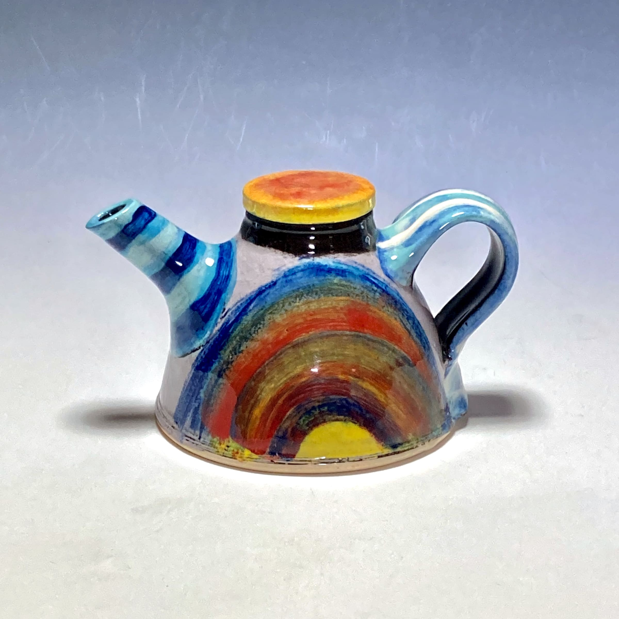 """<span class=""""link fancybox-details-link""""><a href=""""/artists/100-john-pollex/works/7850-john-pollex-teapot-2021/"""">View Detail Page</a></span><div class=""""artist""""><strong>John Pollex</strong></div> <div class=""""title""""><em>Teapot</em>, 2021</div> <div class=""""signed_and_dated"""">impressed with the artist's seal mark 'JP'</div> <div class=""""medium"""">white earthenware decorated with coloured slips</div> <div class=""""dimensions"""">height. 11 cm x diameter. 13 cm</div><div class=""""copyright_line"""">Own Art: £22 x 10 Months, 0% APR</div>"""