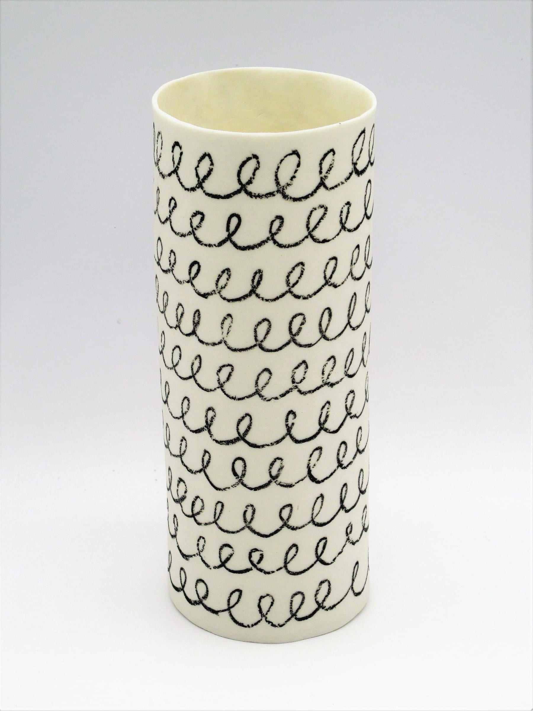"""<span class=""""link fancybox-details-link""""><a href=""""/artists/226-jane-muende/works/7159-jane-muende-white-cylinder-with-black-drawn-helter-skelter-in-2020/"""">View Detail Page</a></span><div class=""""artist""""><strong>Jane Muende</strong></div> <div class=""""title""""><em>White cylinder with black drawn helter skelter in wax crayon</em>, 2020</div> <div class=""""medium"""">Hand built in paper porcelain</div> <div class=""""dimensions"""">15 cm x 5.5 cm </div><div class=""""price"""">£140.00</div><div class=""""copyright_line"""">Own Art: £14 x 10 months 0% APR</div>"""