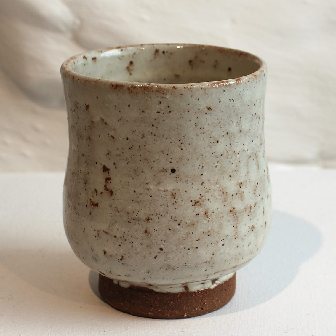 """<span class=""""link fancybox-details-link""""><a href=""""/artists/200-matthew-tyas/works/5460-matthew-tyas-tenmoku-ash-glaze-yunomi-2018/"""">View Detail Page</a></span><div class=""""artist""""><strong>Matthew Tyas</strong></div> <div class=""""title""""><em>Tenmoku Ash Glaze Yunomi</em>, 2018</div> <div class=""""signed_and_dated"""">stamped by the artist</div> <div class=""""medium"""">glazed thrown stoneware</div><div class=""""copyright_line"""">Copyright The Artist</div>"""