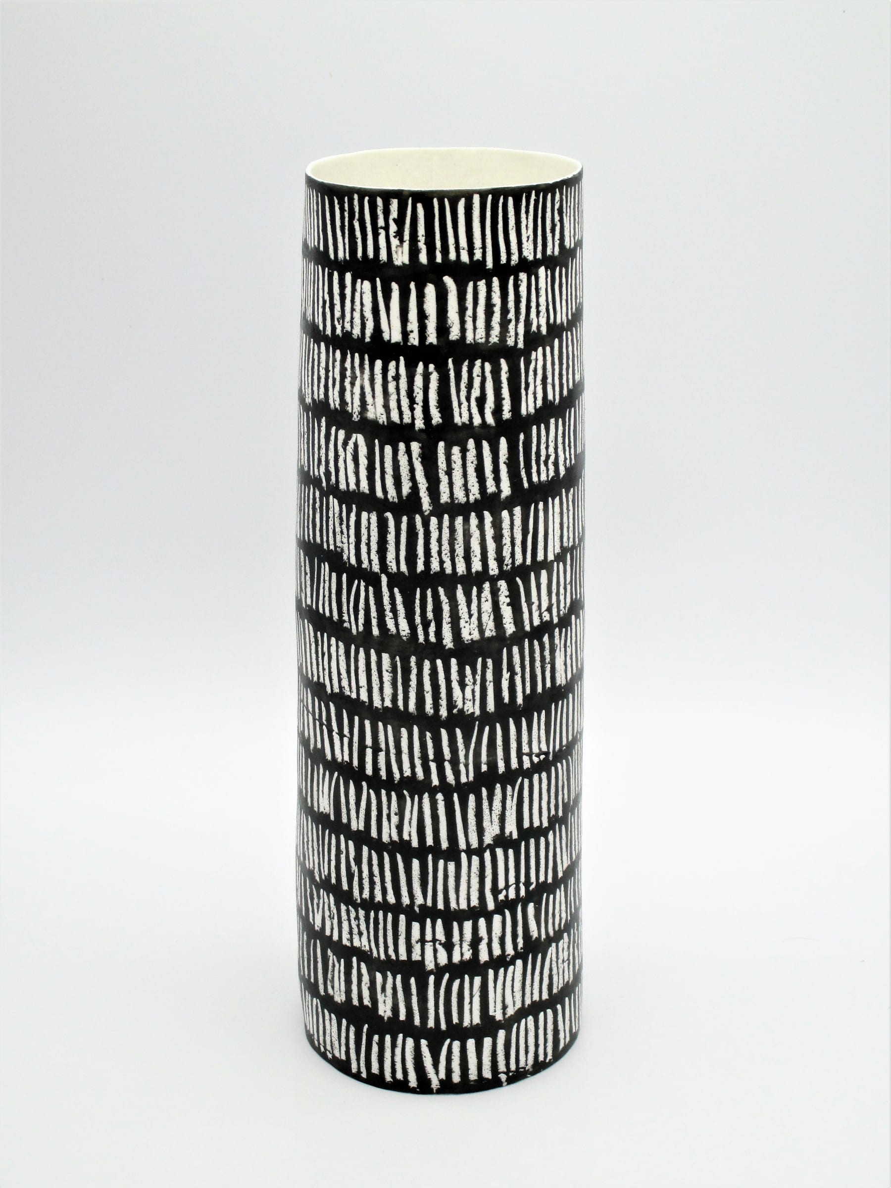 """<span class=""""link fancybox-details-link""""><a href=""""/artists/226-jane-muende/works/7163-jane-muende-velvet-black-cylinder-with-repeated-drawn-verticle-line-2020/"""">View Detail Page</a></span><div class=""""artist""""><strong>Jane Muende</strong></div> <div class=""""title""""><em>Velvet black cylinder with repeated drawn verticle line in white wax crayon</em>, 2020</div> <div class=""""medium"""">Hand built in paper porcelain</div> <div class=""""dimensions"""">24 cm x 7.5 cm </div><div class=""""price"""">£245.00</div><div class=""""copyright_line"""">Own Art: £24.50 x 10 months 0% APR</div>"""