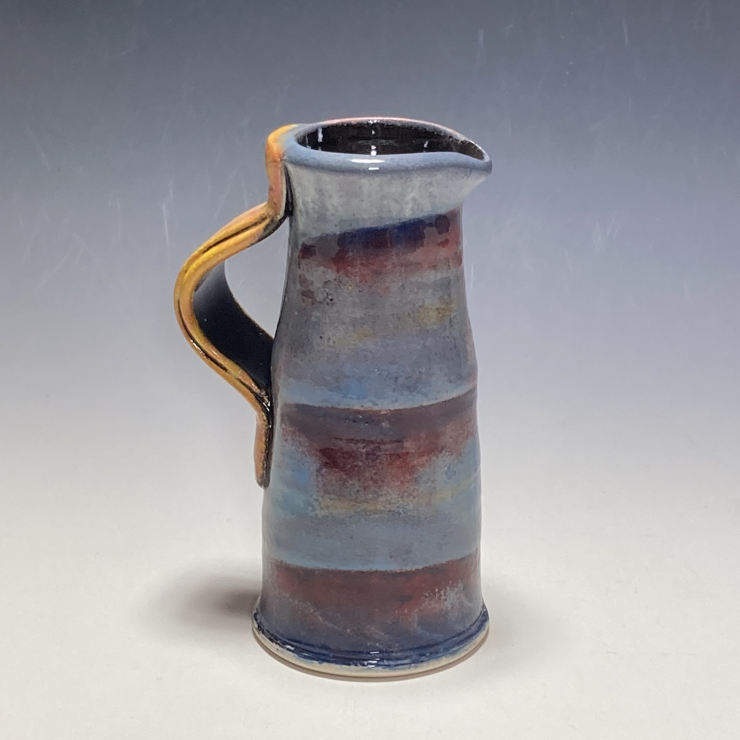 """<span class=""""link fancybox-details-link""""><a href=""""/artists/100-john-pollex/works/7851-john-pollex-medium-jug-2021/"""">View Detail Page</a></span><div class=""""artist""""><strong>John Pollex</strong></div> <div class=""""title""""><em>Medium Jug</em>, 2021</div> <div class=""""signed_and_dated"""">impressed with the artist's seal mark 'JP'</div> <div class=""""medium"""">white earthenware decorated with coloured slips</div> <div class=""""dimensions"""">height. 16.5 cm x diameter. 6 cm</div><div class=""""price"""">£99.00</div><div class=""""copyright_line"""">Own Art: £9.90 x 10 Months, 0% APR</div>"""
