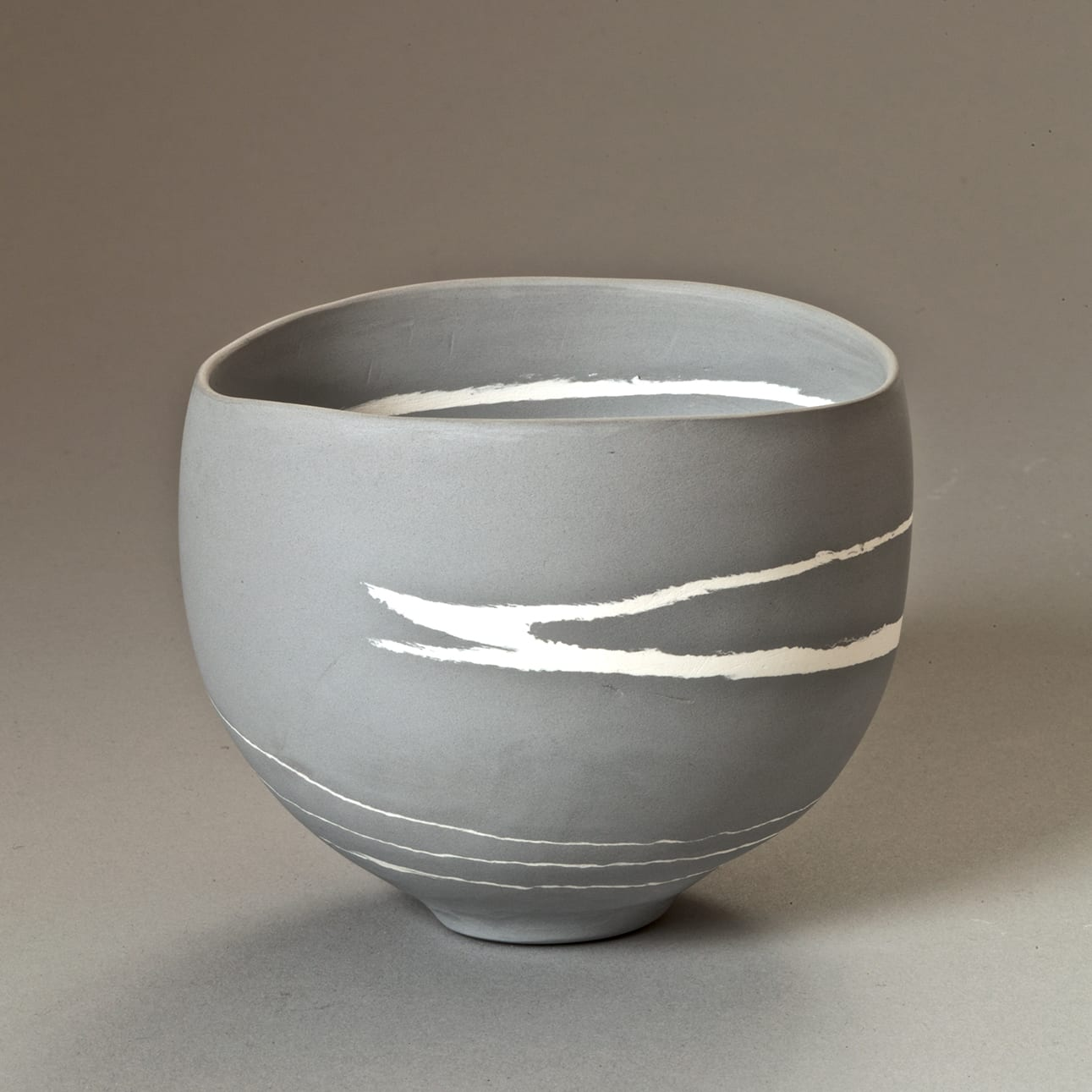 """<span class=""""link fancybox-details-link""""><a href=""""/content/feature/35/artworks7971/"""">View Detail Page</a></span><div class=""""signed_and_dated"""">signed to the base</div> <div class=""""medium"""">grey and white porcelain</div> <div class=""""dimensions"""">h. 8 cm x dia. 10 cm</div>"""