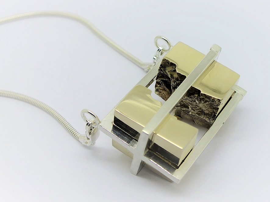 """<span class=""""link fancybox-details-link""""><a href=""""/artists/154-stacey-west/works/3931-stacey-west-interlocking-strata-pendant-porthgwidden-2017/"""">View Detail Page</a></span><div class=""""artist""""><strong>Stacey West</strong></div> <div class=""""title""""><em>'Interlocking Strata' Pendant – 'Porthgwidden'</em>, 2017</div> <div class=""""medium"""">Sterling silver with brass moving interlocking elements on sterling silver chain</div><div class=""""price"""">£365.00</div><div class=""""copyright_line"""">Copyright The Artist</div>"""