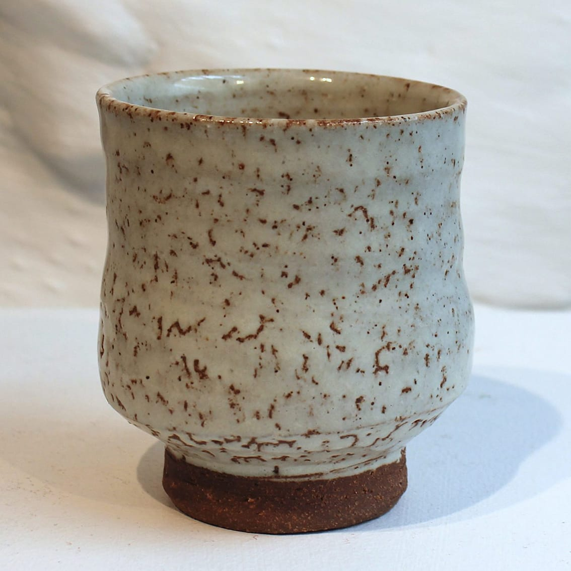 """<span class=""""link fancybox-details-link""""><a href=""""/artists/200-matthew-tyas/works/5461-matthew-tyas-tenmoku-shino-glaze-yunomi-2018/"""">View Detail Page</a></span><div class=""""artist""""><strong>Matthew Tyas</strong></div> <div class=""""title""""><em>Tenmoku Shino Glaze Yunomi</em>, 2018</div> <div class=""""signed_and_dated"""">stamped by the artist</div> <div class=""""medium"""">glazed thrown stoneware</div><div class=""""copyright_line"""">Copyright The Artist</div>"""
