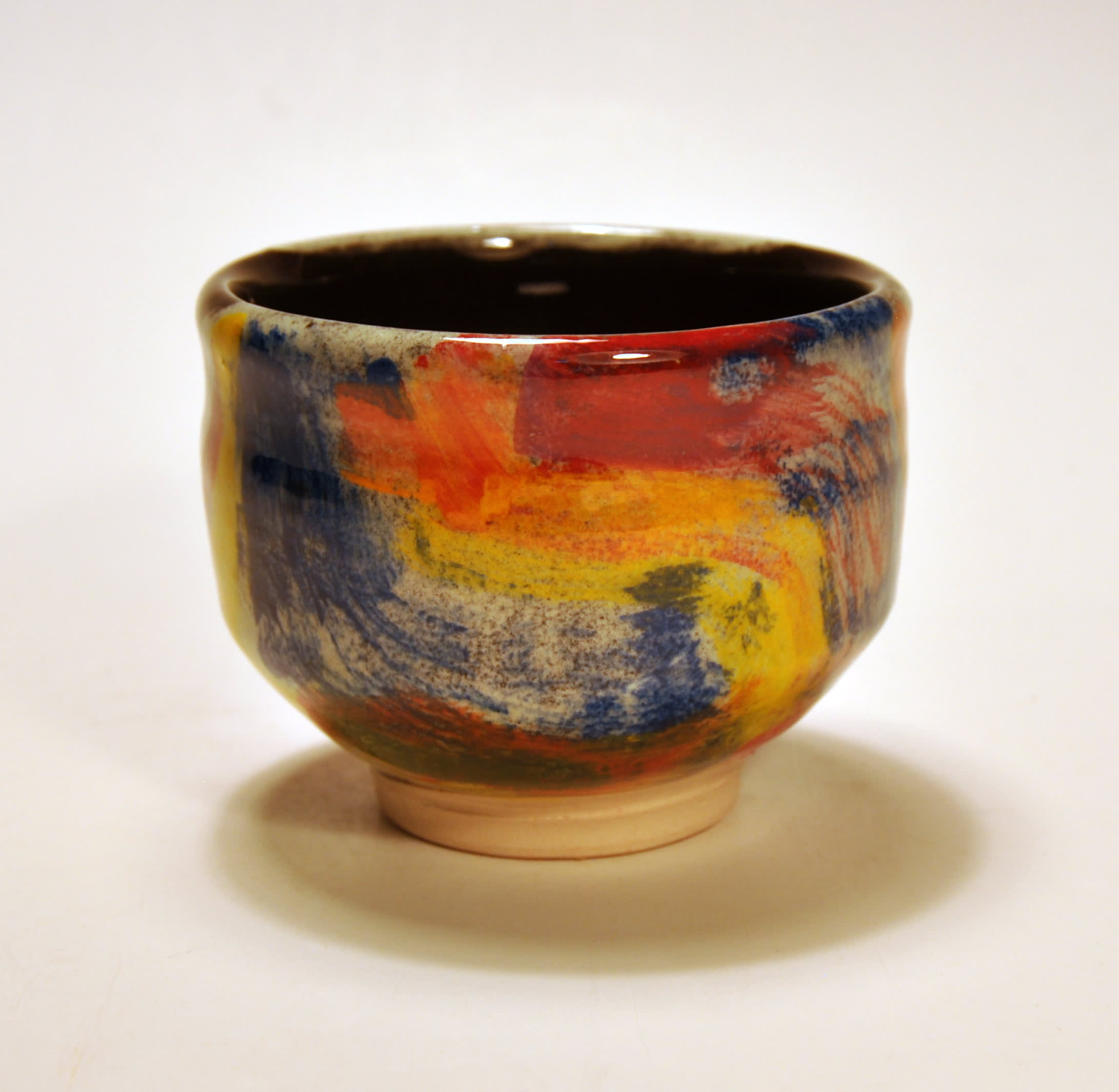 """<span class=""""link fancybox-details-link""""><a href=""""/artists/100-john-pollex/works/5380-john-pollex-tea-bowl-2018/"""">View Detail Page</a></span><div class=""""artist""""><strong>John Pollex</strong></div> b. 1941 <div class=""""title""""><em>Tea Bowl</em>, 2018</div> <div class=""""signed_and_dated"""">impressed with the artist's seal mark 'JP'</div> <div class=""""medium"""">white earthenware decorated with coloured slips</div><div class=""""price"""">£70.00</div><div class=""""copyright_line"""">Copyright the Artist</div>"""
