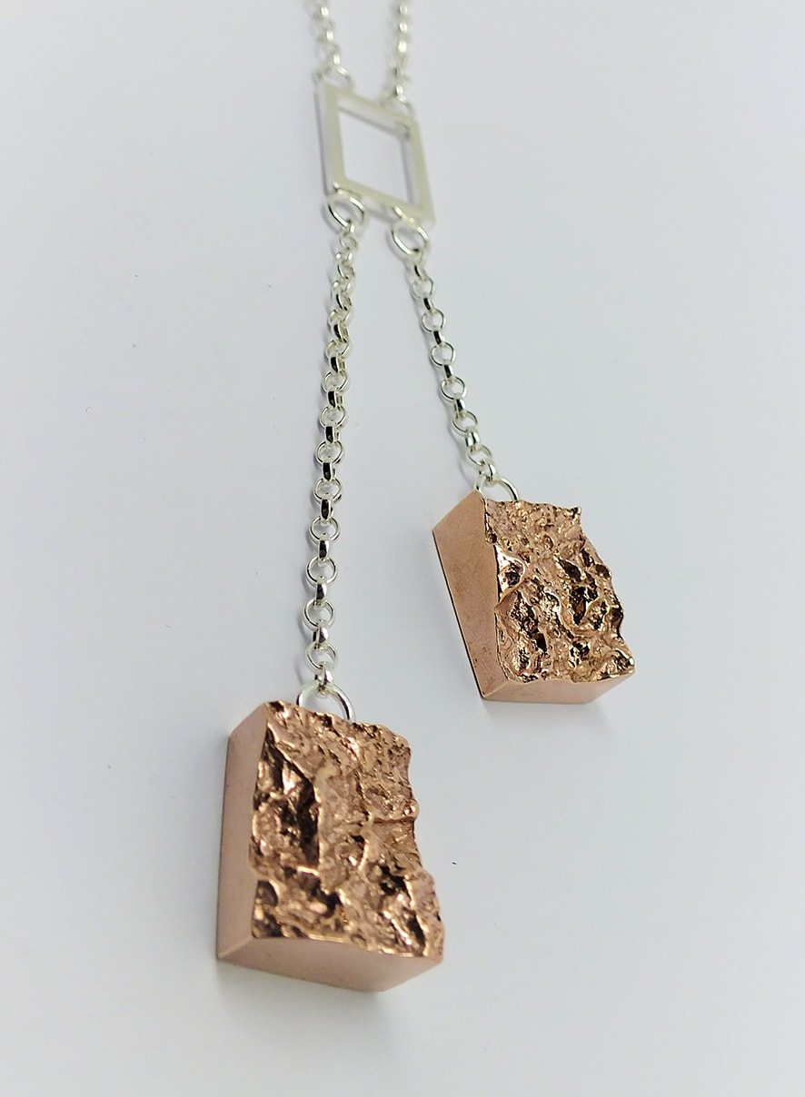 """<span class=""""link fancybox-details-link""""><a href=""""/artists/154-stacey-west/works/3932-stacey-west-interlocking-strata-necklace-harbour-wall-2017/"""">View Detail Page</a></span><div class=""""artist""""><strong>Stacey West</strong></div> <div class=""""title""""><em>'Interlocking Strata' Necklace – 'Harbour Wall'</em>, 2017</div> <div class=""""medium"""">Red bronze and sterling silver interlocking</div><div class=""""copyright_line"""">Copyright The Artist</div>"""