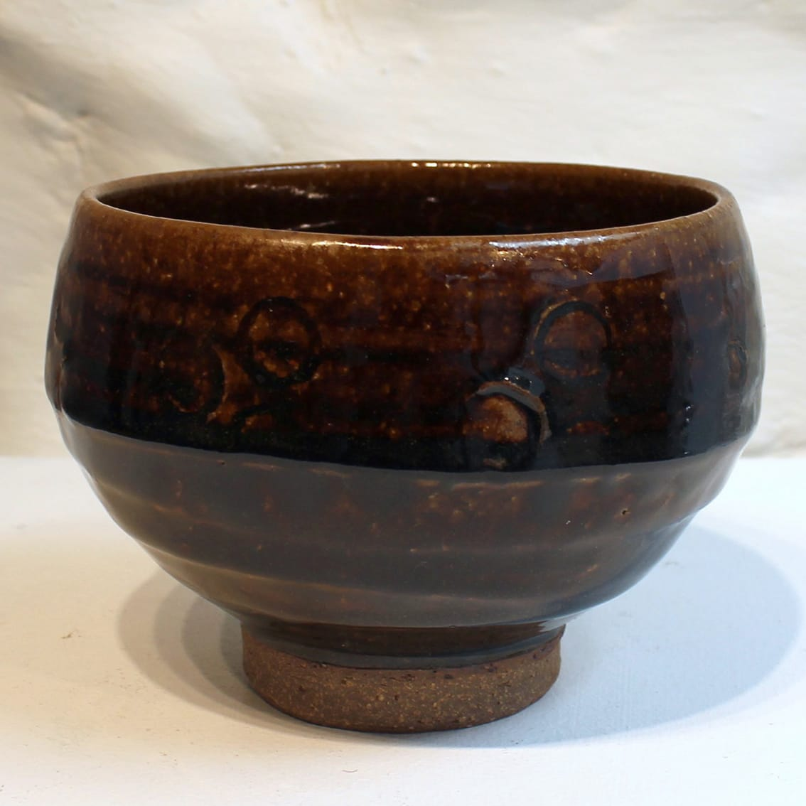 """<span class=""""link fancybox-details-link""""><a href=""""/artists/200-matthew-tyas/works/5454-matthew-tyas-toffee-chawan-bowl-2018/"""">View Detail Page</a></span><div class=""""artist""""><strong>Matthew Tyas</strong></div> <div class=""""title""""><em>Toffee Chawan Bowl</em>, 2018</div> <div class=""""signed_and_dated"""">stamped by the artist</div> <div class=""""medium"""">glazed thrown stoneware</div><div class=""""copyright_line"""">Copyright The Artist</div>"""