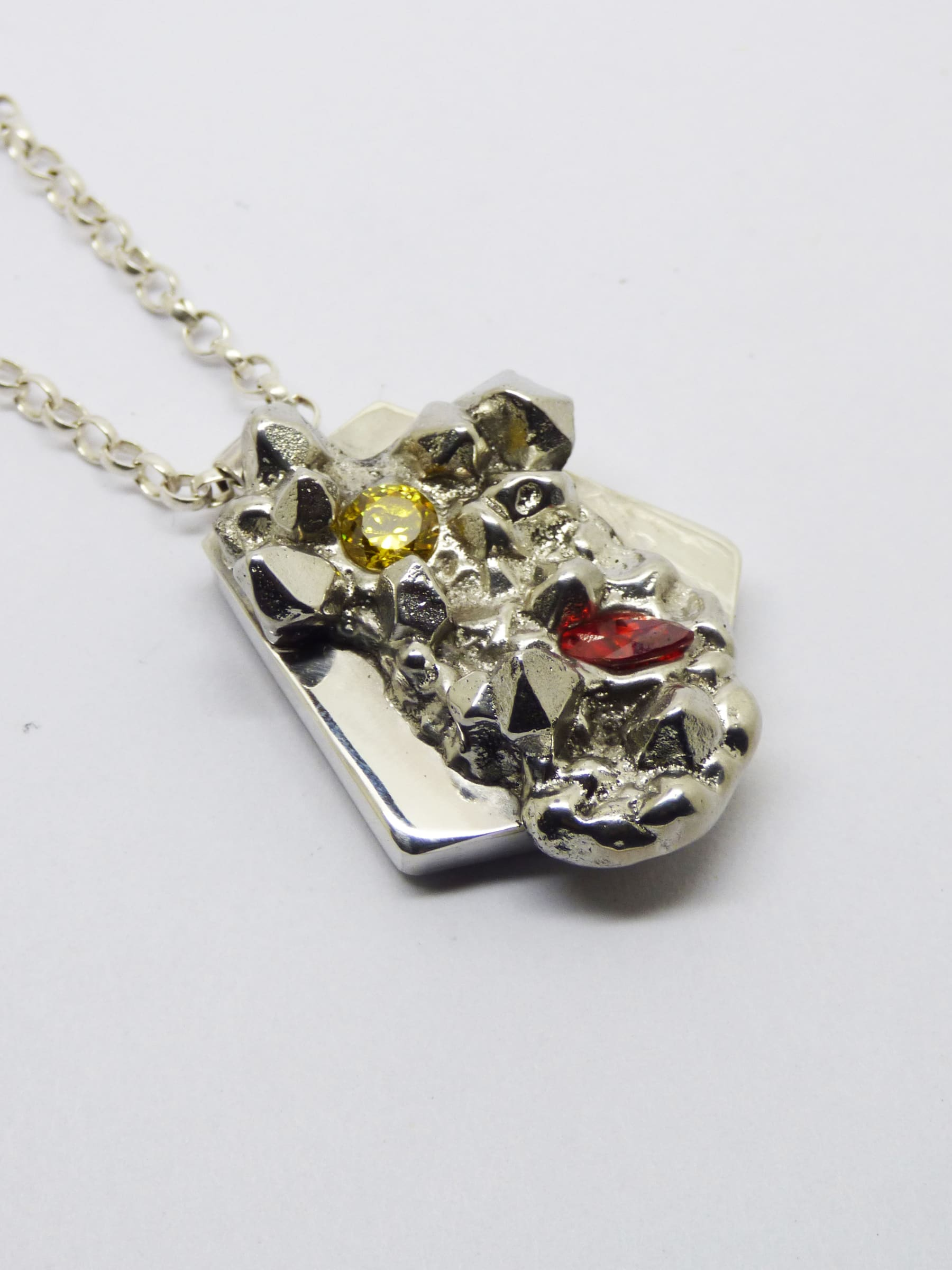 """<span class=""""link fancybox-details-link""""><a href=""""/artists/154-stacey-west/works/4900-stacey-west-found-treasures-pendant-large-2017/"""">View Detail Page</a></span><div class=""""artist""""><strong>Stacey West</strong></div> <div class=""""title""""><em>'Found Treasures' Pendant – large</em>, 2017</div> <div class=""""medium"""">Pewter and silver pendant on sterling silver chain with red and yellow cubic zirconia. -Large 16""""</div><div class=""""price"""">£145.00</div><div class=""""copyright_line"""">Copyright The Artist</div>"""