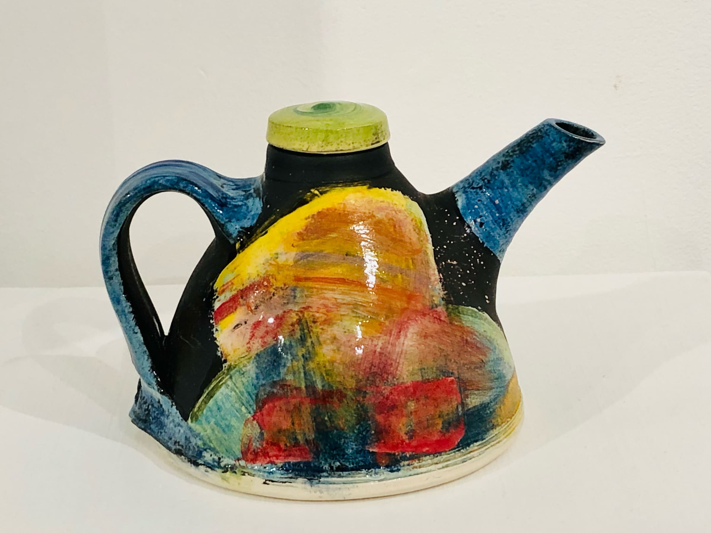 """<span class=""""link fancybox-details-link""""><a href=""""/artists/100-john-pollex/works/7417-john-pollex-teapot-2020/"""">View Detail Page</a></span><div class=""""artist""""><strong>John Pollex</strong></div> b. 1941 <div class=""""title""""><em>Teapot</em>, 2020</div> <div class=""""signed_and_dated"""">impressed with the artist's seal mark 'JP'</div> <div class=""""medium"""">white earthenware decorated with coloured slips</div><div class=""""copyright_line"""">£22 x 10 month 0% APR</div>"""