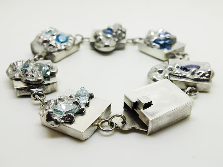 """<span class=""""link fancybox-details-link""""><a href=""""/artists/154-stacey-west/works/3937-stacey-west-found-treasures-luxury-bracelet-2017/"""">View Detail Page</a></span><div class=""""artist""""><strong>Stacey West</strong></div> <div class=""""title""""><em>'Found Treasures' Luxury Bracelet</em>, 2017</div> <div class=""""medium"""">Pewter and silver with handcrafted sterling silver clasp and aqua/blue cubic zirconia</div><div class=""""price"""">£880.00</div><div class=""""copyright_line"""">Copyright The Artist</div>"""