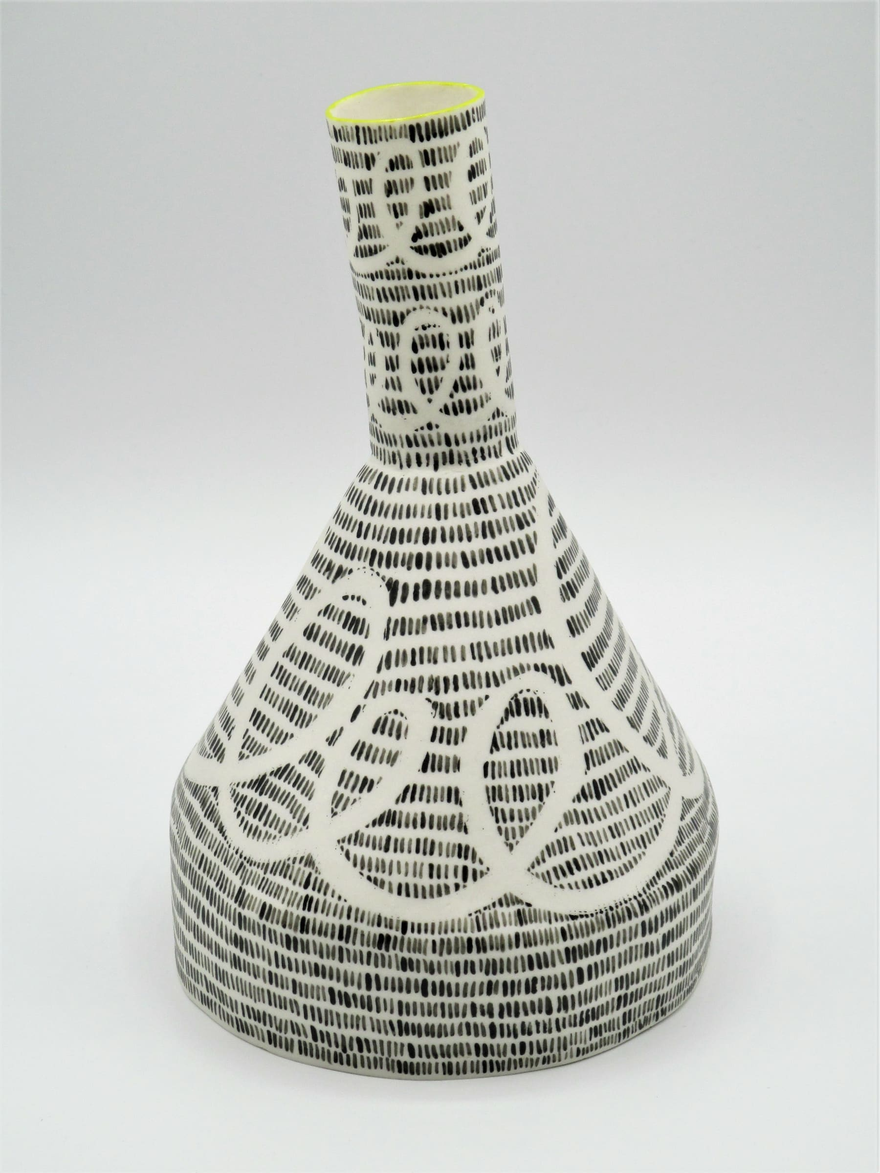 """<span class=""""link fancybox-details-link""""><a href=""""/artists/226-jane-muende/works/7156-jane-muende-conical-bottle-with-drawn-helter-skelter-and-lines-2020/"""">View Detail Page</a></span><div class=""""artist""""><strong>Jane Muende</strong></div> <div class=""""title""""><em>Conical bottle with drawn helter skelter and lines in wax crayon, lime green rim.</em>, 2020</div> <div class=""""medium"""">Hand built in paper porcelain</div> <div class=""""dimensions"""">24 x 13 cm</div><div class=""""copyright_line"""">Own Art: £24.50 x 10 months 0% APR</div>"""