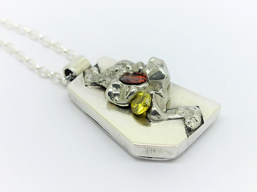 """<span class=""""link fancybox-details-link""""><a href=""""/artists/154-stacey-west/works/3941-stacey-west-found-treasures-pendant-large-2017/"""">View Detail Page</a></span><div class=""""artist""""><strong>Stacey West</strong></div> <div class=""""title""""><em>'Found Treasures' Pendant – large</em>, 2017</div> <div class=""""medium"""">Pewter and silver with red and yellow cubic zirconia on sterling silver 18"""" chain</div><div class=""""price"""">£135.00</div><div class=""""copyright_line"""">Copyright The Artist</div>"""