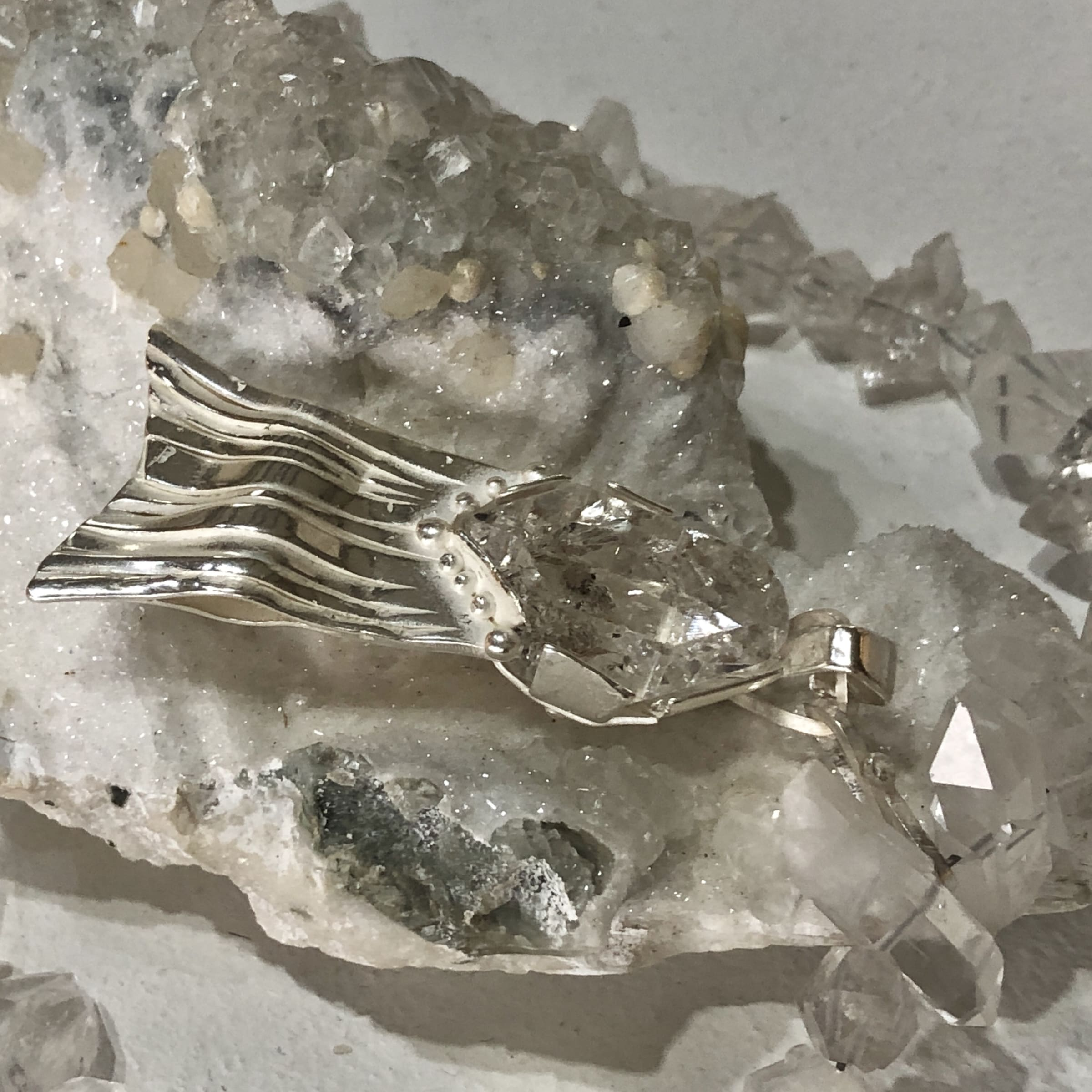 "<span class=""link fancybox-details-link""><a href=""/artists/186-helen-feiler/works/6760-helen-feiler-sculptural-double-ended-quartz-crystal-and-silver-fish-2019/"">View Detail Page</a></span><div class=""artist""><strong>Helen Feiler</strong></div> <div class=""title""><em>Sculptural Double Ended Quartz Crystal and Silver 'Fish' Pendant with Double Quartz Crystal Beads on Quartz Boulder</em>, 2019</div> <div class=""medium"">Double ended quartz crystal and silver with double ended quartz crystal beads and quartz crystal boulder sculpture</div><div class=""copyright_line"">Own Art: £110.00 x 10 monthly payments</div>"