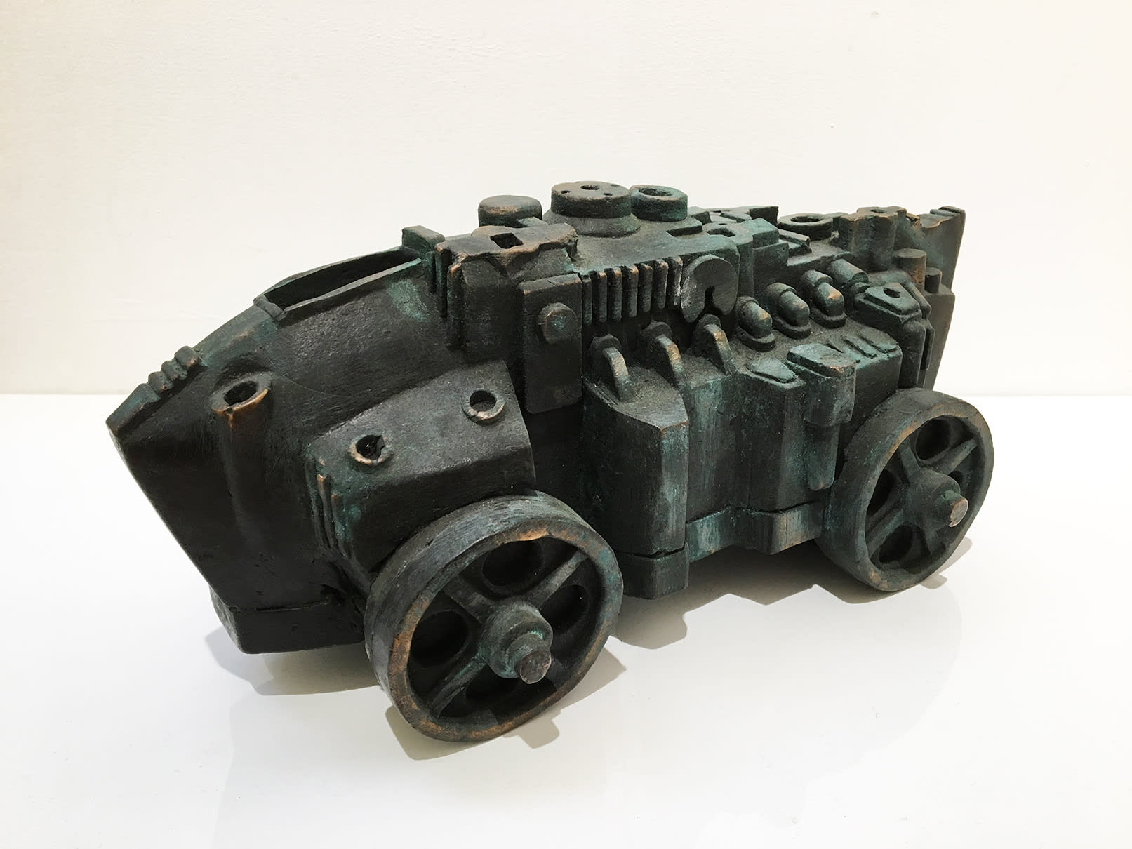 """<span class=""""link fancybox-details-link""""><a href=""""/artists/60-eduardo-paolozzi/works/434-eduardo-paolozzi-engine-racing-car-c.1998/"""">View Detail Page</a></span><div class=""""artist""""><strong>Eduardo Paolozzi</strong></div> 1924-2005 <div class=""""title""""><em>Engine - Racing Car</em>, c.1998</div> <div class=""""signed_and_dated"""">signed (inscribed on base)</div> <div class=""""medium"""">cast bronze</div> <div class=""""dimensions"""">6 1/8 x 6 3/4 x 13 3/8 in<br /> h:15.5 x w:17 x l:34 cm</div>"""