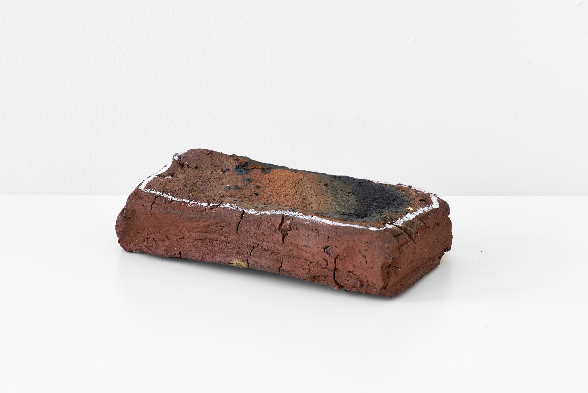 <span class=&#34;link fancybox-details-link&#34;><a href=&#34;/exhibitions/169/works/artworks10720/&#34;>View Detail Page</a></span><div class=&#34;medium&#34;>Handmade brick from local clay, correction fluid</div> <div class=&#34;dimensions&#34;>5.5 x 23.5 x 12 cm<br /> 2 1/8 x 9 1/4 x 4 3/4 in</div>