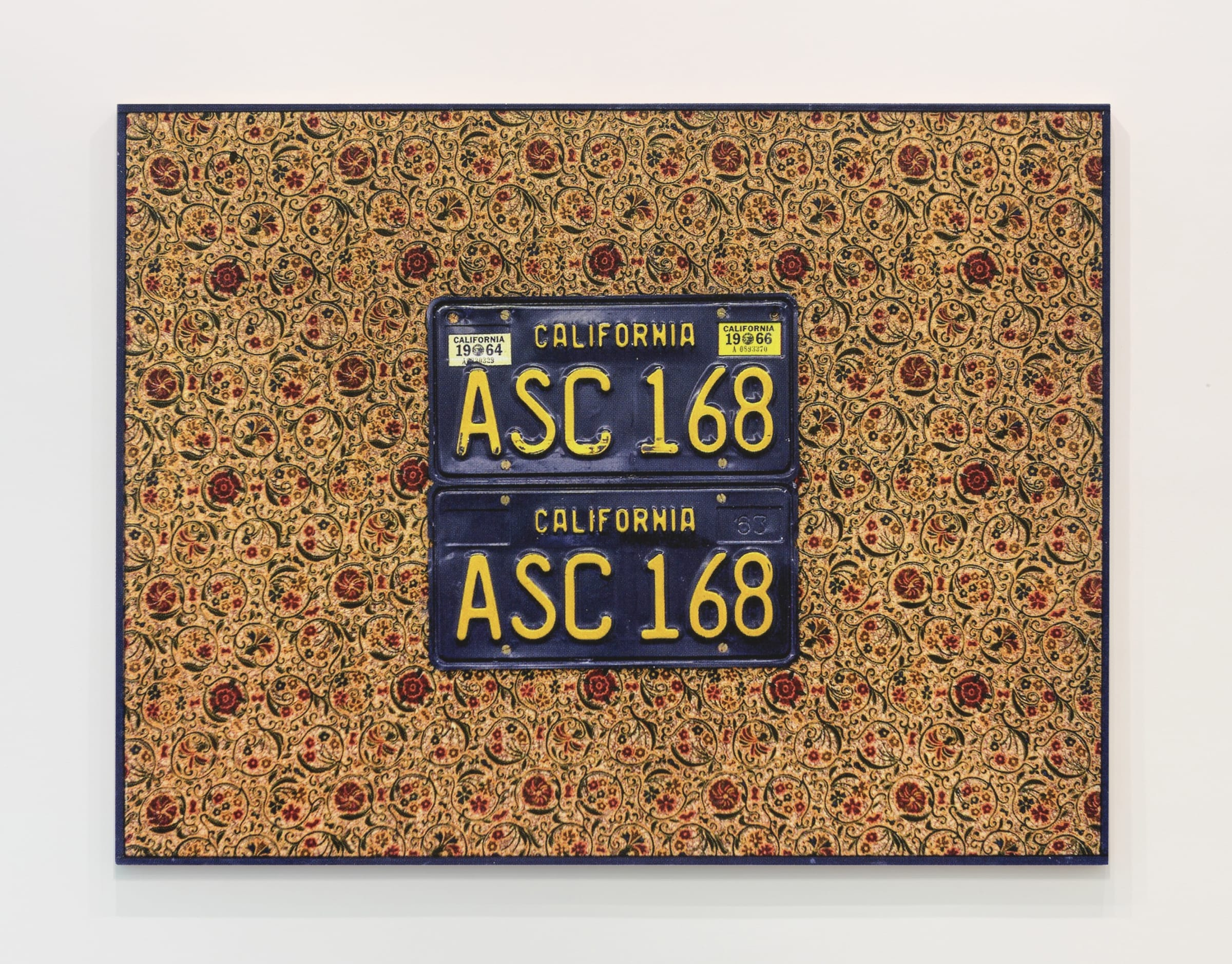 "<span class=""link fancybox-details-link""><a href=""/exhibitions/555/works/artworks_standalone11050/"">View Detail Page</a></span><div class=""medium"">License plates on fabric on panel</div>