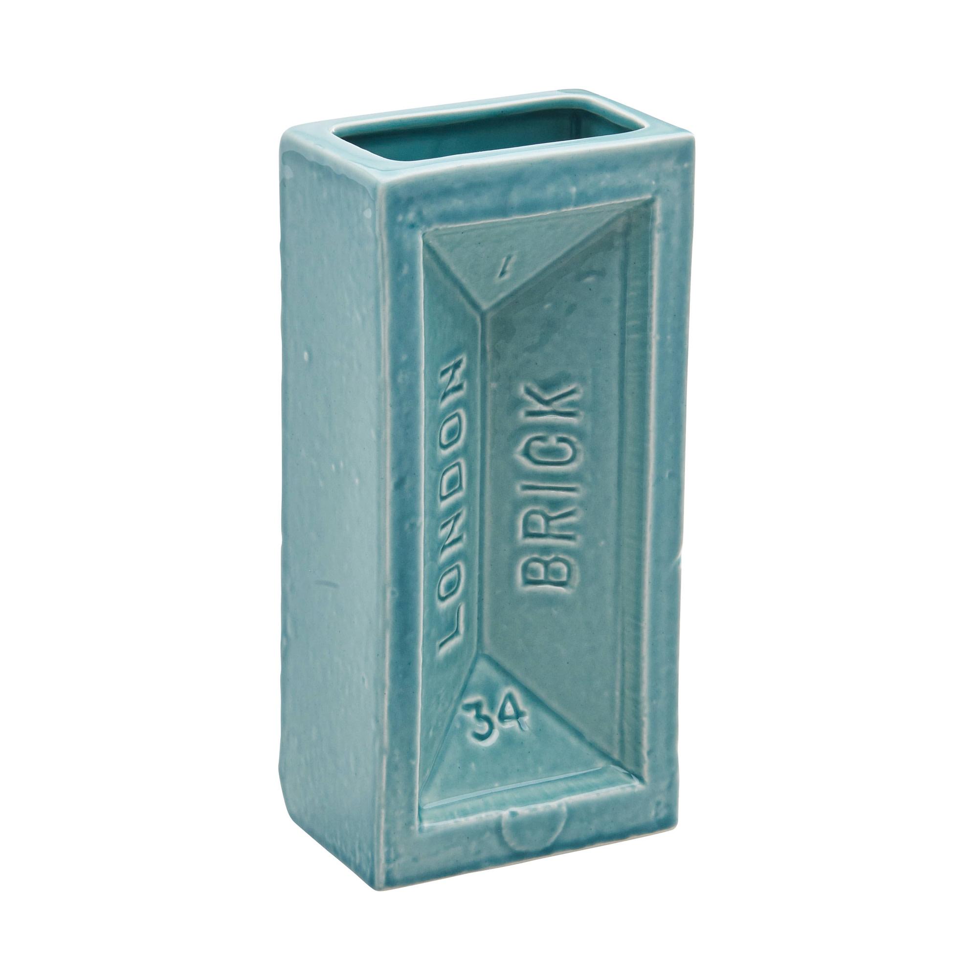 """<span class=""""link fancybox-details-link""""><a href=""""/artists/37-stolen-form/works/112-stolen-form-brick-vase-aqua/"""">View Detail Page</a></span><div class=""""artist""""><strong>Stolen Form</strong></div> <div class=""""title""""><em>Brick Vase - Aqua</em></div> <div class=""""medium"""">Ceramic</div> <div class=""""dimensions"""">20 x 10 x 6 cm</div> <div class=""""edition_details""""></div><div class=""""price"""">£26.67</div>"""