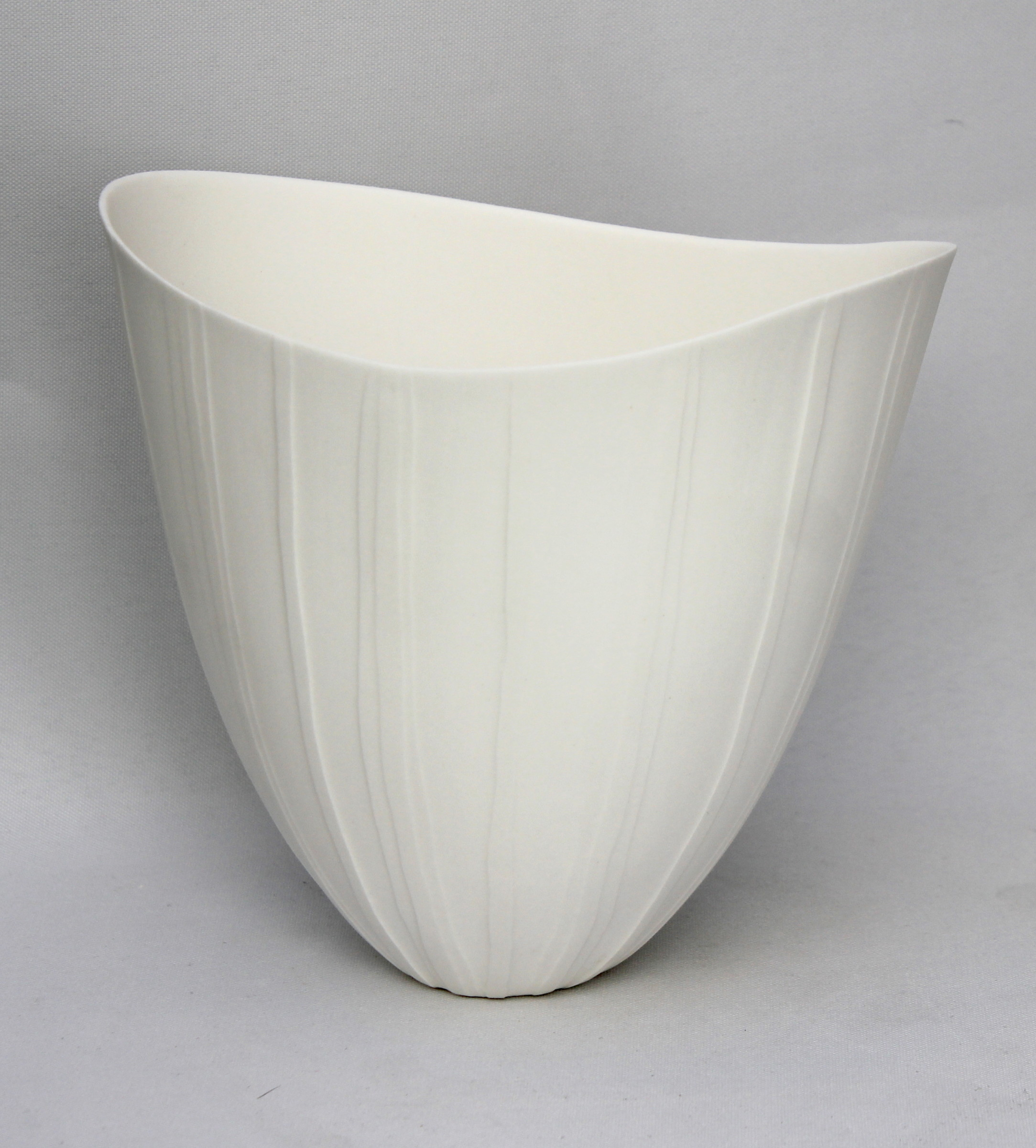"<span class=""link fancybox-details-link""><a href=""/artists/60-sasha-wardell/works/4127-sasha-wardell-medium-ripple-vase-2017/"">View Detail Page</a></span><div class=""artist""><strong>Sasha Wardell</strong></div> <div class=""title""><em>Medium Ripple Vase</em>, 2017</div> <div class=""signed_and_dated"">inscribed with artist initials on base</div> <div class=""medium"">layered and sliced bone china</div> <div class=""dimensions"">h. 18 x w. 18 cm</div><div class=""copyright_line"">OwnArt: £ 19 x 10 Months, 0% APR</div>"