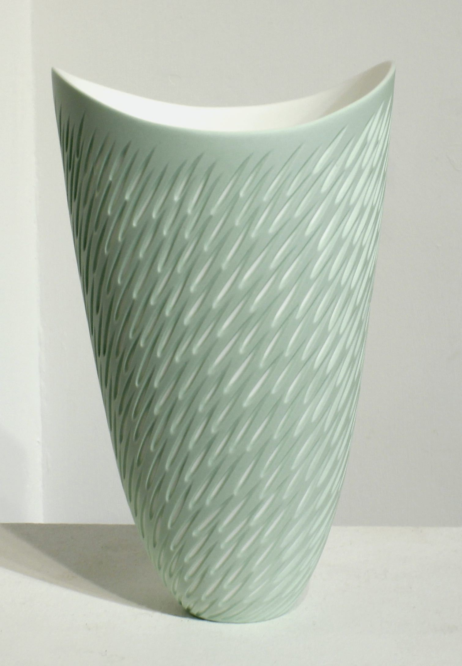 "<span class=""link fancybox-details-link""><a href=""/artists/60-sasha-wardell/works/5115-sasha-wardell-green-shoal-vase-2017/"">View Detail Page</a></span><div class=""artist""><strong>Sasha Wardell</strong></div> <div class=""title""><em>Green Shoal Vase </em>, 2017</div> <div class=""signed_and_dated"">inscribed with artist initials on base</div> <div class=""medium"">layered and sliced bone china</div> <div class=""dimensions"">h. 25 x w. 15 x d. 12 cm</div>"
