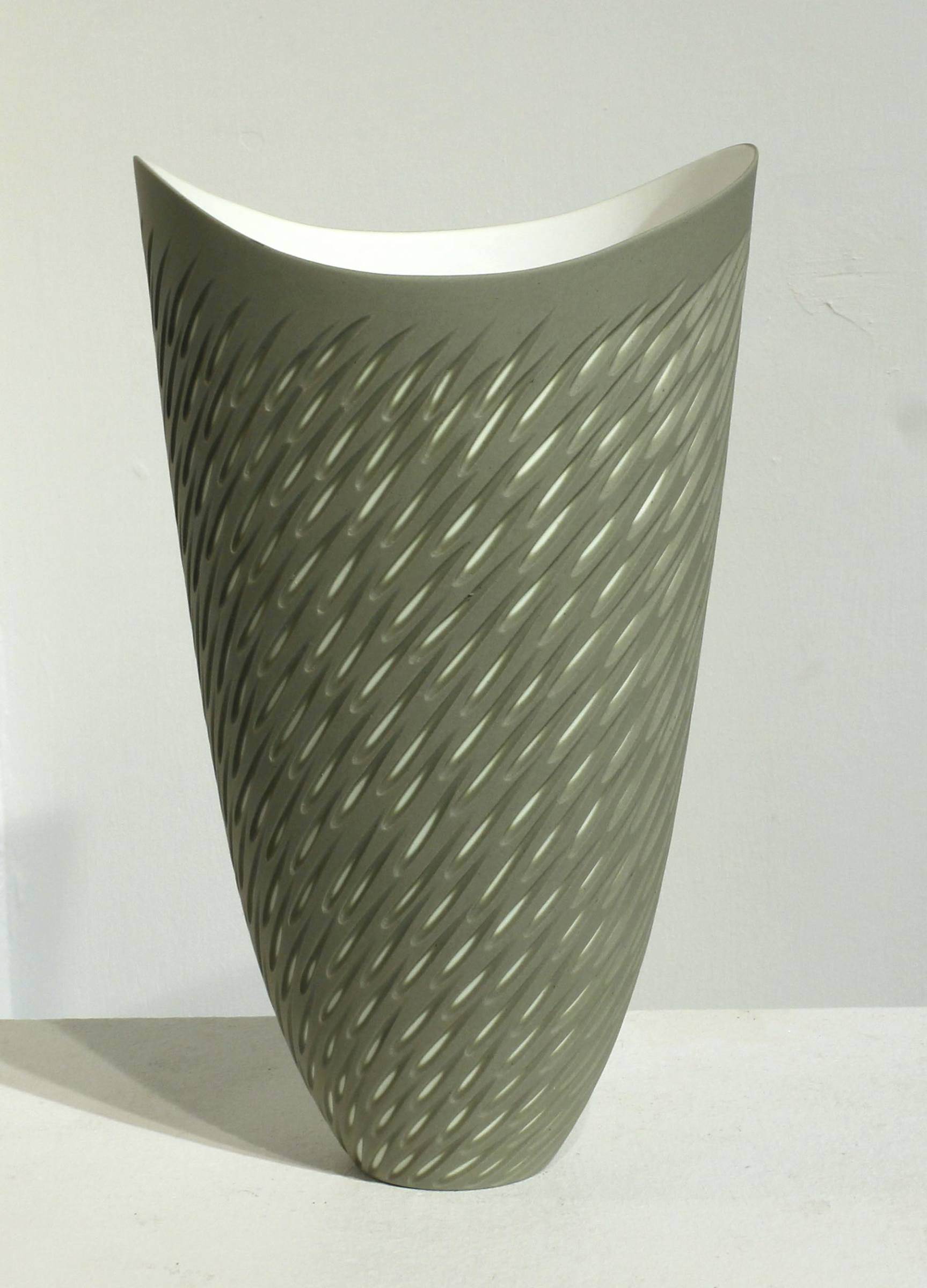 "<span class=""link fancybox-details-link""><a href=""/artists/60-sasha-wardell/works/5114-sasha-wardell-olive-shoal-vase-2017/"">View Detail Page</a></span><div class=""artist""><strong>Sasha Wardell</strong></div> <div class=""title""><em>Olive Shoal Vase </em>, 2017</div> <div class=""signed_and_dated"">inscribed with artist initials on base</div> <div class=""medium"">layered and sliced bone china</div> <div class=""dimensions"">h. 25 x w. 15 x d. 12 cm</div>"