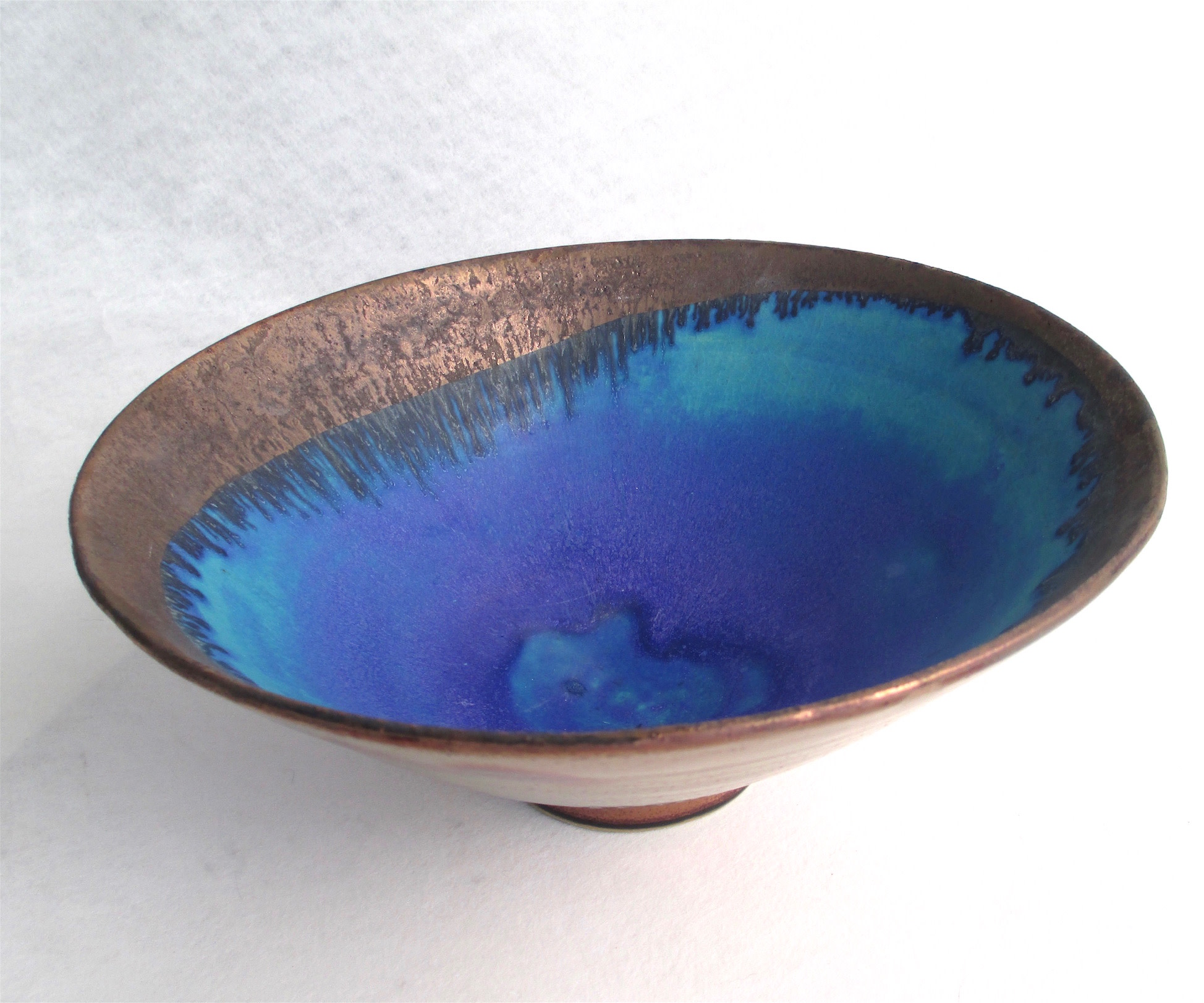 "<span class=""link fancybox-details-link""><a href=""/artists/44-sarah-perry/works/6403-sarah-perry-copper-lustred-blue-pool-bowl-2019/"">View Detail Page</a></span><div class=""artist""><strong>Sarah Perry</strong></div> <div class=""title""><em>Copper Lustred Blue Pool Bowl</em>, 2019</div> <div class=""signed_and_dated"">maker's impressed stamp to base</div> <div class=""medium"">wheel-thrown stoneware</div> <div class=""dimensions"">d29 x h13cm</div><div class=""copyright_line"">Copyright The Artist</div>"