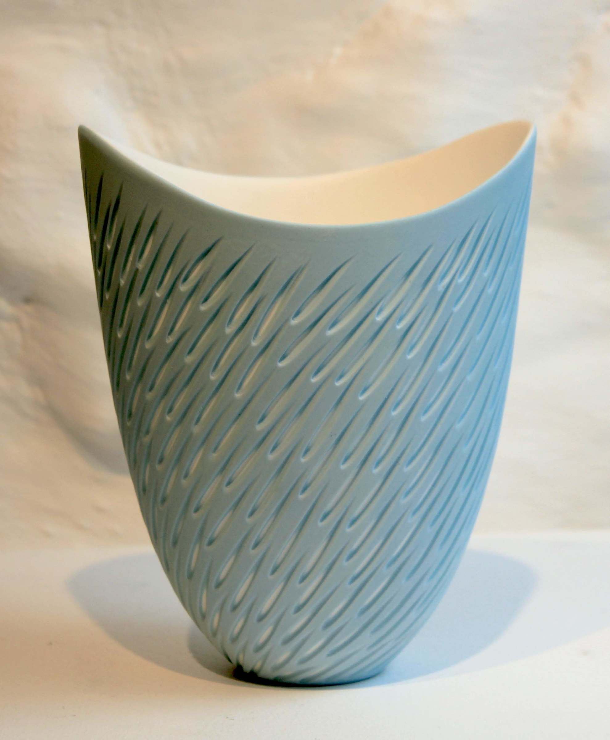 "<span class=""link fancybox-details-link""><a href=""/artists/60-sasha-wardell/works/5494-sasha-wardell-shoal-vase-2018/"">View Detail Page</a></span><div class=""artist""><strong>Sasha Wardell</strong></div> <div class=""title""><em>Shoal Vase</em>, 2018</div> <div class=""signed_and_dated"">inscribed with artist initials on base</div> <div class=""medium"">blue/white layered & sliced china</div> <div class=""dimensions"">17 x 14 cm<br /> 6 3/4 x 5 1/2 inches</div><div class=""copyright_line"">OwnArt: £ 19 x 10 Months, 0% APR</div>"