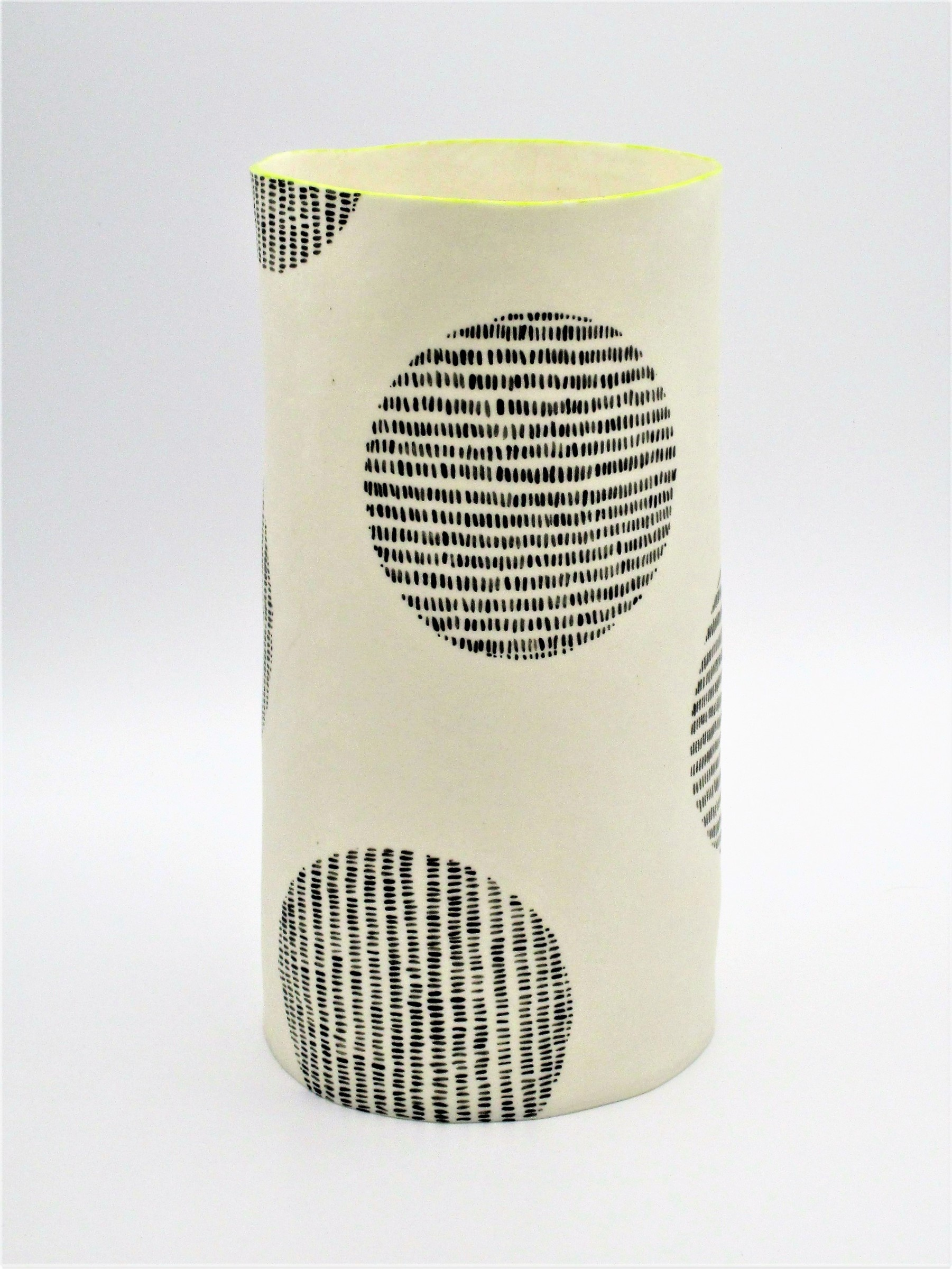 """<span class=""""link fancybox-details-link""""><a href=""""/artists/226-jane-muende/works/7161-jane-muende-translucent-white-cylinder-with-black-painted-stitch-lines-2020/"""">View Detail Page</a></span><div class=""""artist""""><strong>Jane Muende</strong></div> <div class=""""title""""><em>Translucent white cylinder with black painted 'stitch lines' within circle, lime green rim</em>, 2020</div> <div class=""""medium"""">Hand built in paper porcelain</div> <div class=""""dimensions"""">22 cm x 11 cm </div><div class=""""price"""">£245.00</div><div class=""""copyright_line"""">Own Art: £24.50 x 10 months 0% APR</div>"""