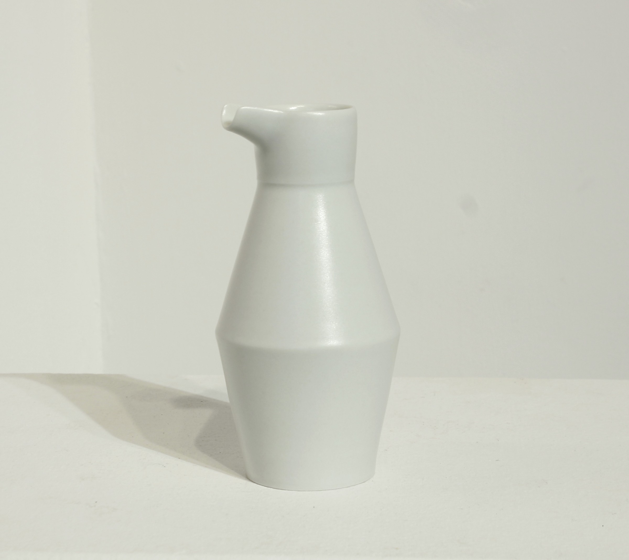 "<span class=""link fancybox-details-link""><a href=""/artists/33-sun-kim/works/5102-sun-kim-milk-jug-2017/"">View Detail Page</a></span><div class=""artist""><strong>Sun Kim</strong></div> <div class=""title""><em>Milk Jug </em>, 2017</div> <div class=""signed_and_dated"">stamped by the artist</div> <div class=""medium"">porcelain</div> <div class=""dimensions"">h. 13 x w. 6.5 cm </div>"