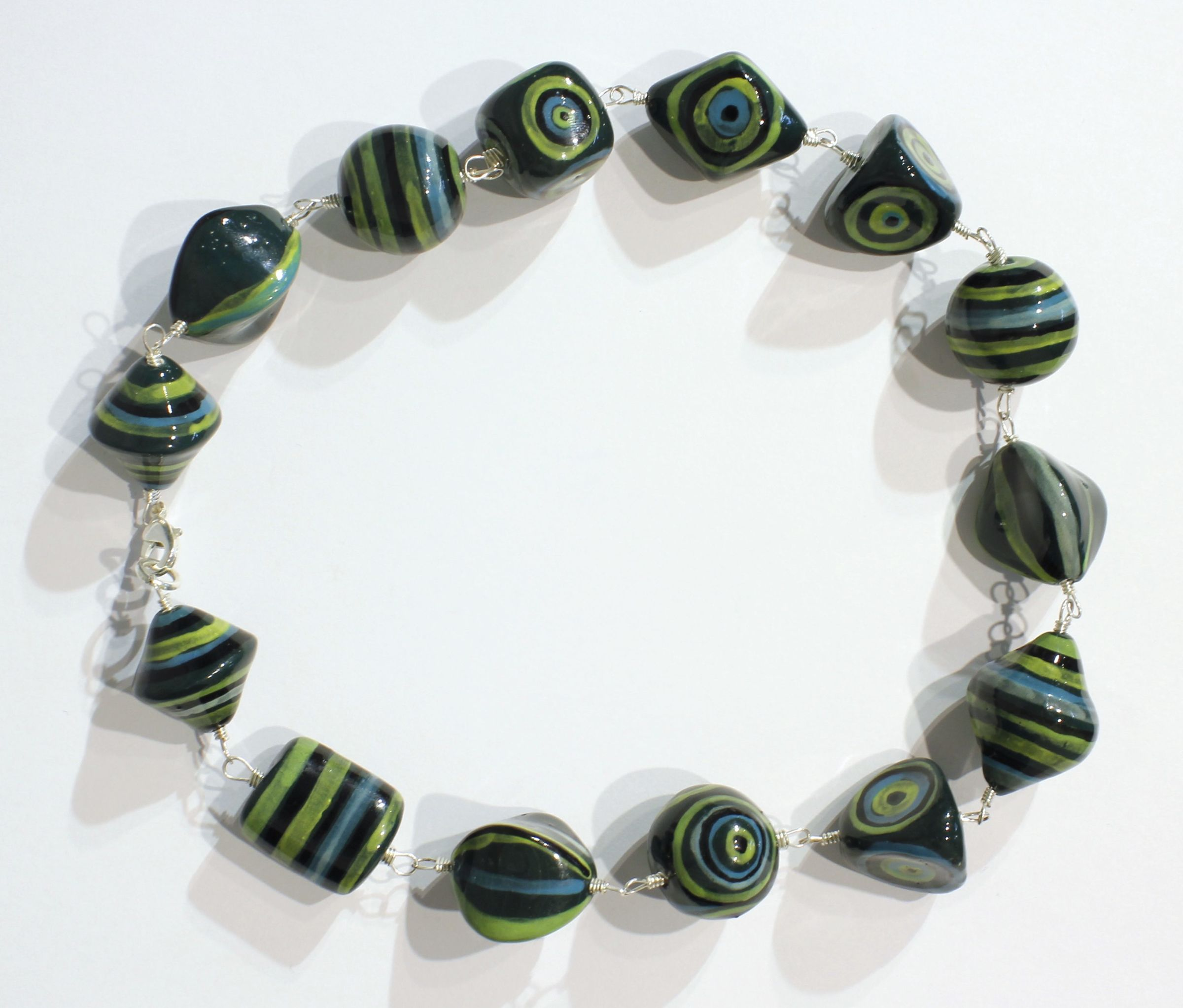 "<span class=""link fancybox-details-link""><a href=""/artists/146-elinor-lamond/works/2510-elinor-lamond-green-and-blue-striped-necklace-2017/"">View Detail Page</a></span><div class=""artist""><strong>Elinor Lamond</strong></div> <div class=""title""><em>Green and Blue Striped Necklace </em>, 2017</div> <div class=""medium"">handmade ceramic beads</div><div class=""price"">£100.00</div><div class=""copyright_line"">Copyright The Artist</div>"