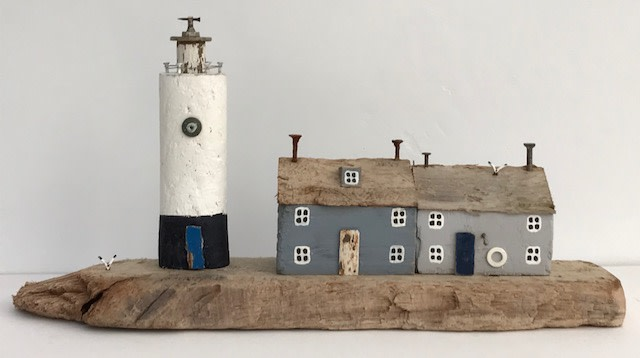 """<span class=""""link fancybox-details-link""""><a href=""""/artists/199-kirsty-elson/works/5136-kirsty-elson-lighthouse-keeper-s-cottages-2018/"""">View Detail Page</a></span><div class=""""artist""""><strong>Kirsty Elson</strong></div> <div class=""""title""""><em>Lighthouse Keeper's Cottages</em>, 2018</div> <div class=""""medium"""">Driftwood, reclaimed nails, beads, reclaimed fishing wire.</div> <div class=""""dimensions"""">15 x 30 x 7 cm<br /> 5 7/8 x 11 3/4 x 2 3/4 inches</div><div class=""""copyright_line"""">OwnArt: £ 22 x 10 Months, 0% APR</div>"""