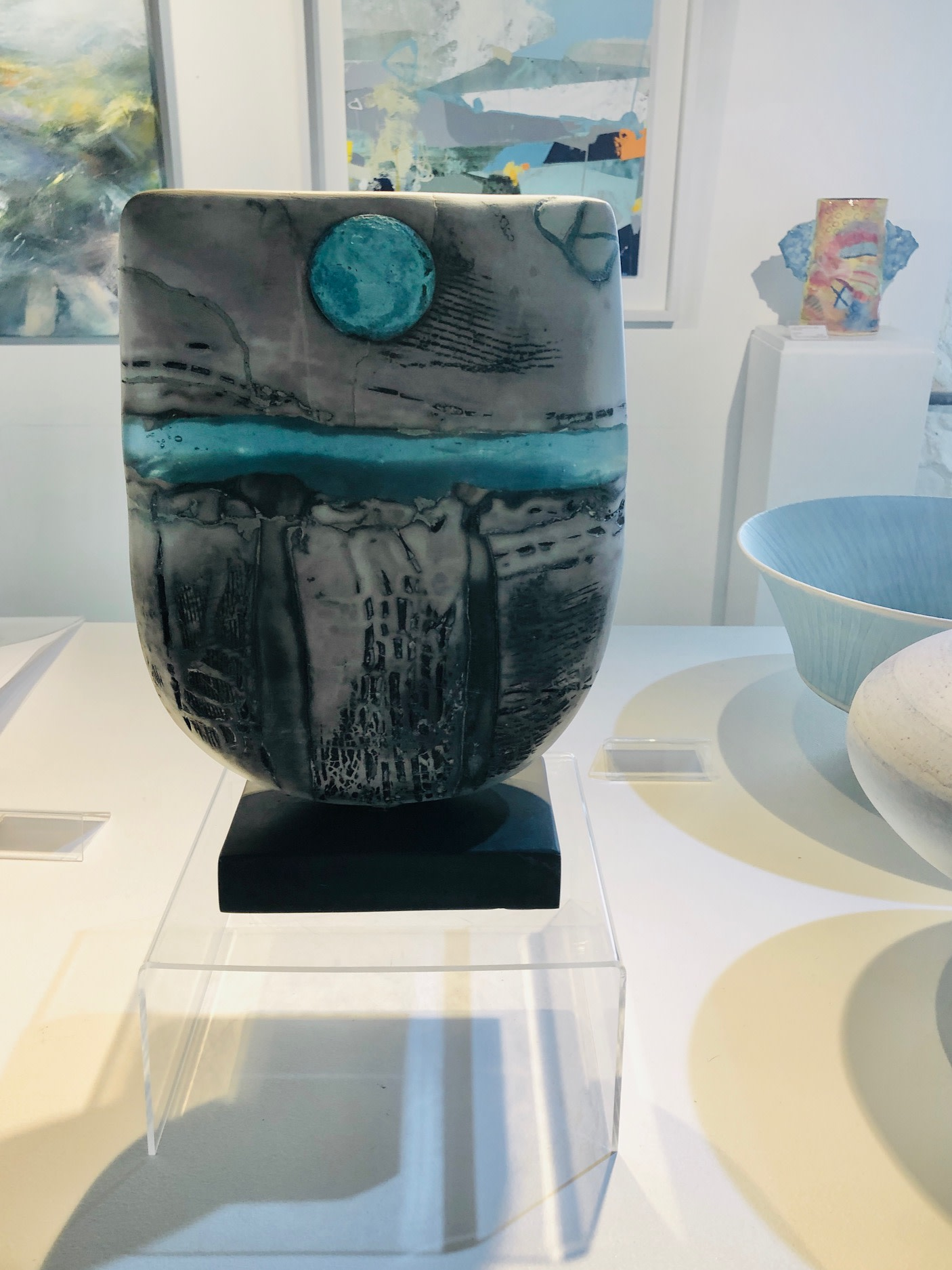 """<span class=""""link fancybox-details-link""""><a href=""""/artists/40-peter-hayes/works/6884-peter-hayes-raku-bow-blue-wave-and-disc-2020/"""">View Detail Page</a></span><div class=""""artist""""><strong>Peter Hayes</strong></div> <div class=""""title""""><em>Raku Bow Blue wave and disc</em>, 2020</div> <div class=""""dimensions"""">h. 30 cm x w. 23 cm</div><div class=""""copyright_line"""">Ownart: £78 x 10 Months, 0% APR</div>"""