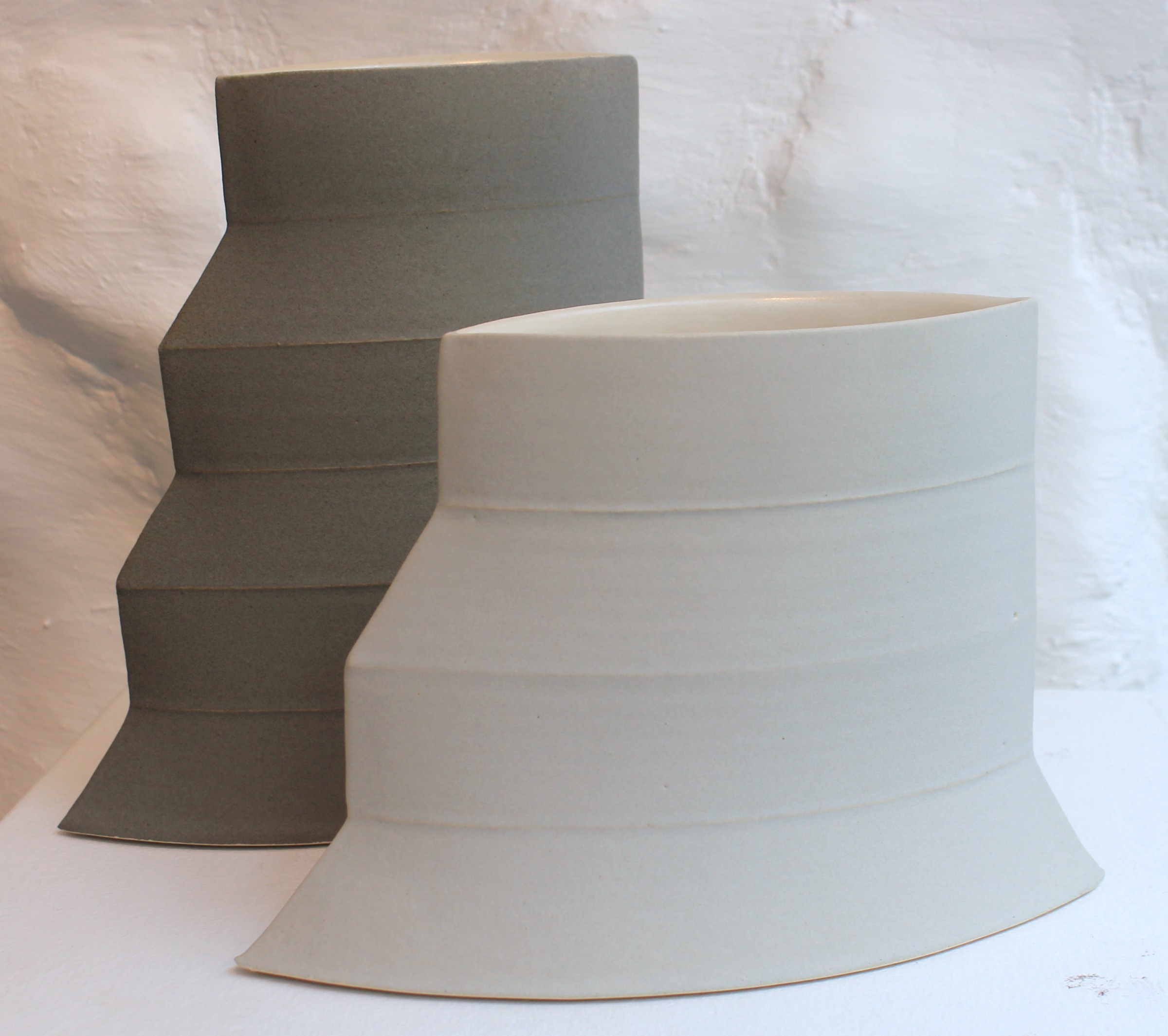 "<span class=""link fancybox-details-link""><a href=""/artists/33-sun-kim/works/5742-sun-kim-pair-of-geometric-vessels-2018/"">View Detail Page</a></span><div class=""artist""><strong>Sun Kim</strong></div> <div class=""title""><em>Pair of Geometric Vessels</em>, 2018</div> <div class=""signed_and_dated"">stamped by the artist</div> <div class=""medium"">porcelain</div> <div class=""dimensions"">C1: 9 x 17 x 4 cm<br /> 3 1/2 x 6 3/4 x 1 5/8 inches<br /> C2: h 14 x w 20 x d 4 cm</div><div class=""price"">£675.00</div><div class=""copyright_line"">OwnArt: £ 67.50 x 10 Months, 0% APR</div>"