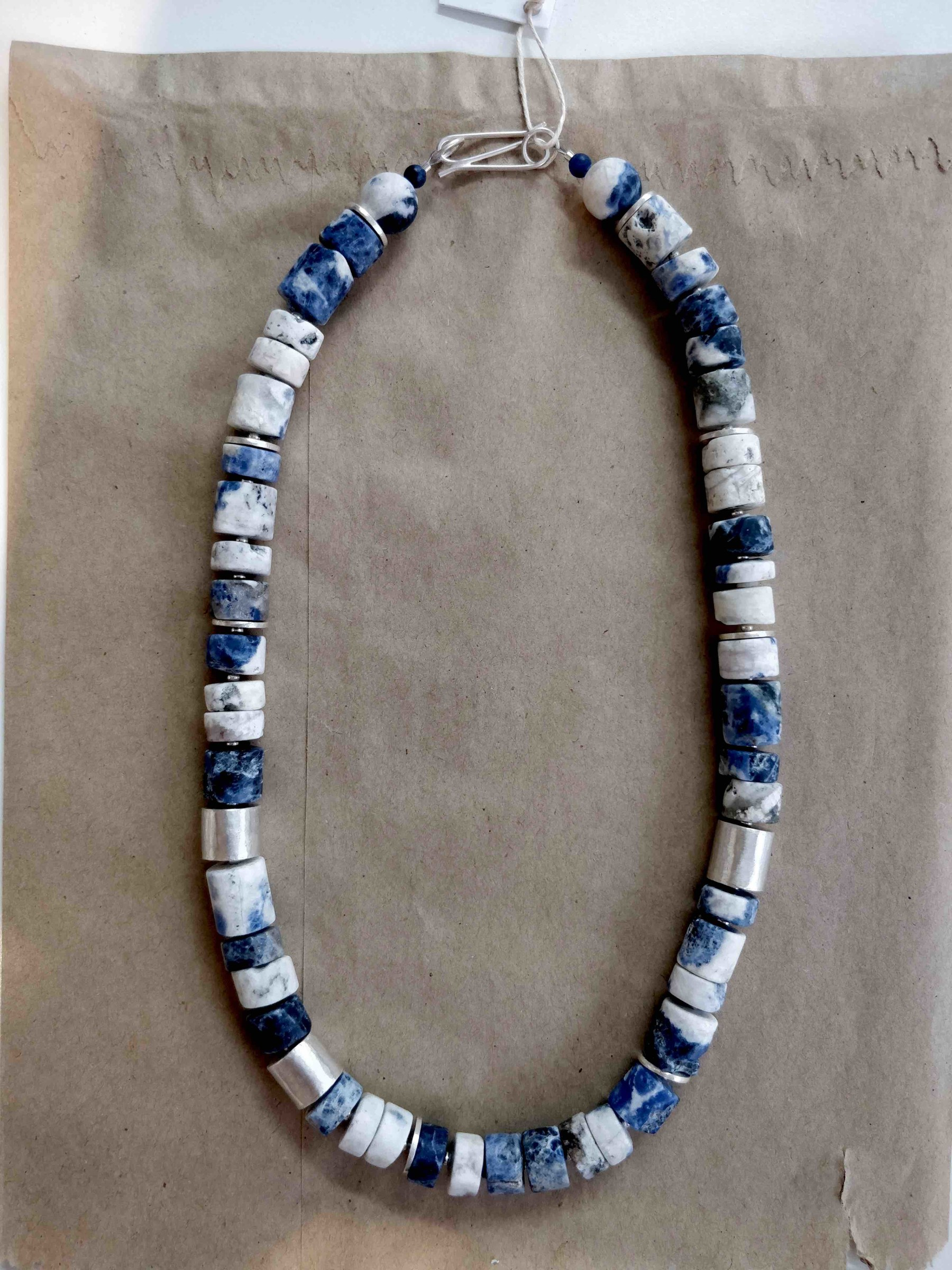 "<span class=""link fancybox-details-link""><a href=""/artists/148-roberta-hopkins/works/5700-roberta-hopkins-white-sodalite-ancient-tubes-2018/"">View Detail Page</a></span><div class=""artist""><strong>Roberta Hopkins</strong></div> <div class=""title""><em>White Sodalite Ancient Tubes</em>, 2018</div> <div class=""medium"">sterling silver</div><div class=""price"">£220.00</div><div class=""copyright_line"">£ 22 x 10 Months, OwnArt 0% APR</div>"